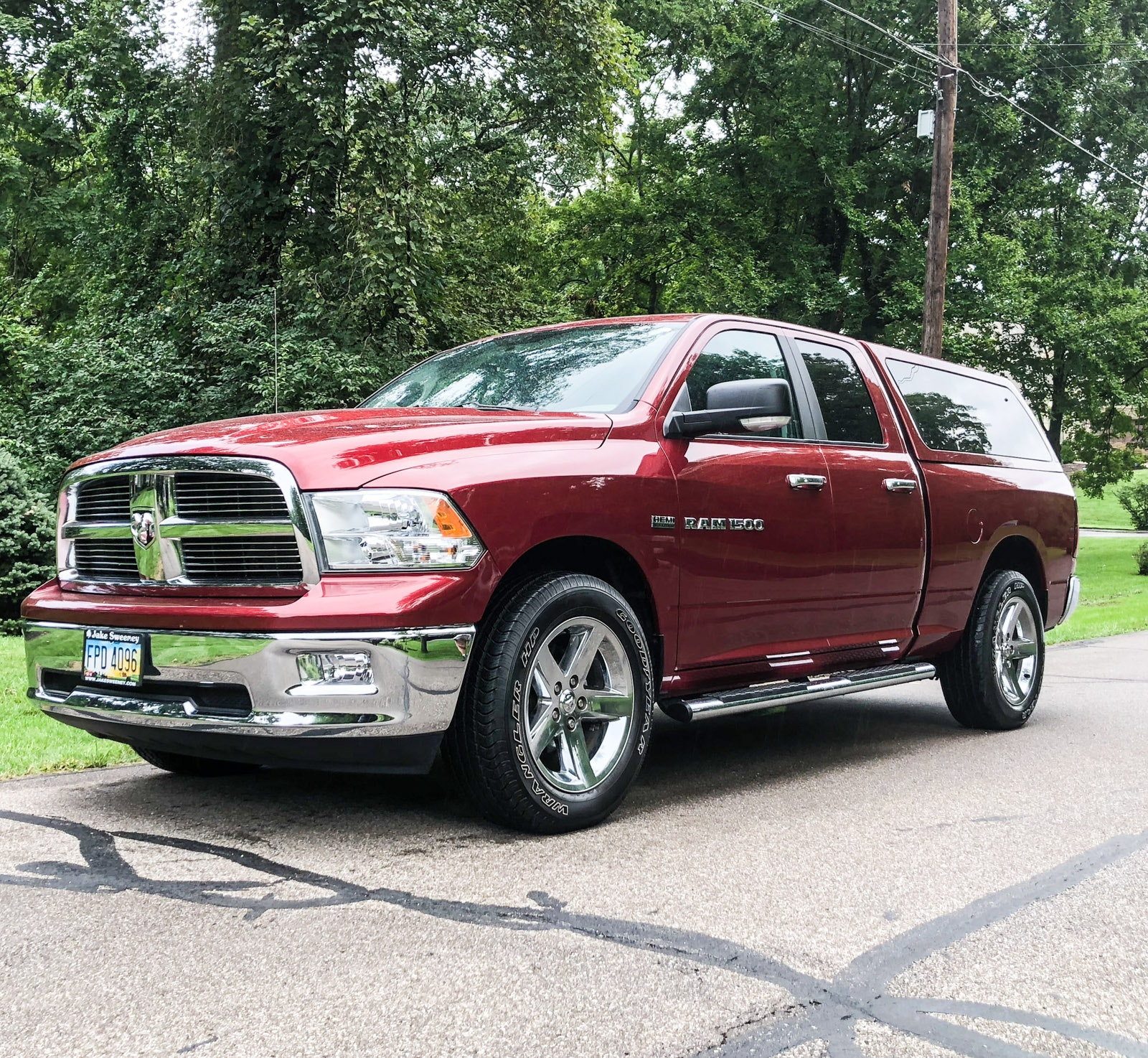 2012 Dodge Ram 1500 Big Horn Quad Cab 4 x 4 Pickup Truck with Custom Leer Cap