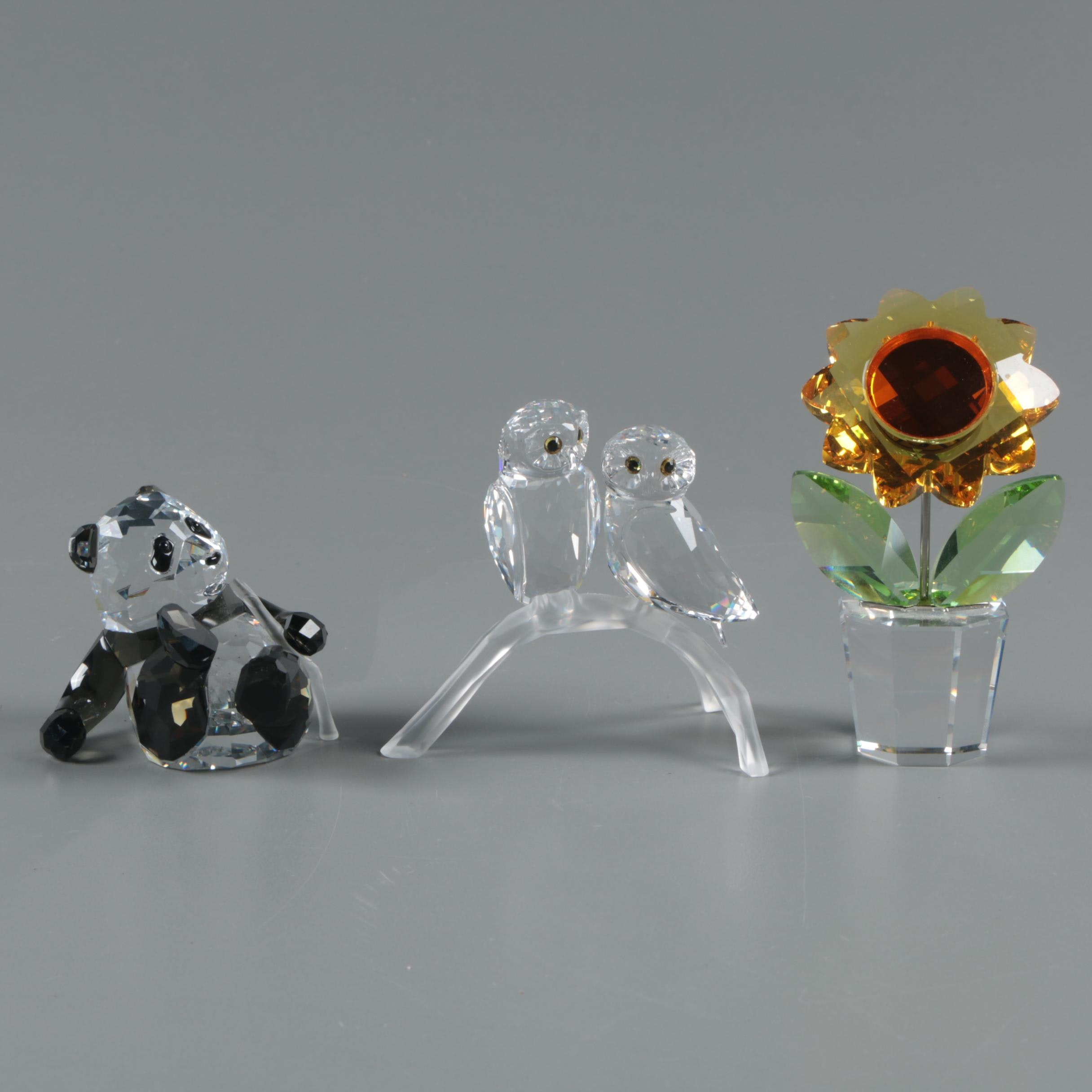 "Swarovski Figurines including ""Panda Cub,"" ""Sunflower,"" and Owls"