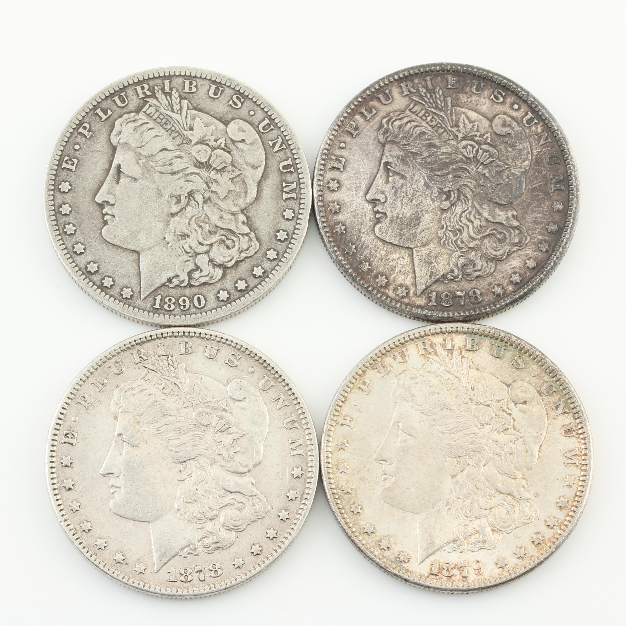 Group of Four Silver Morgan Dollars