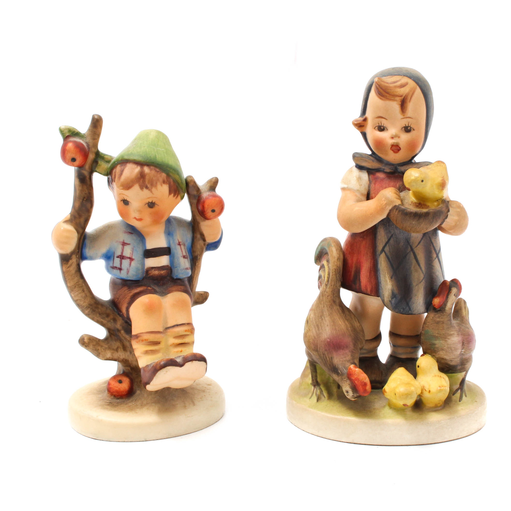 "Hummel Figurines ""Feeding Time"" and ""Apple Tree Boy"""