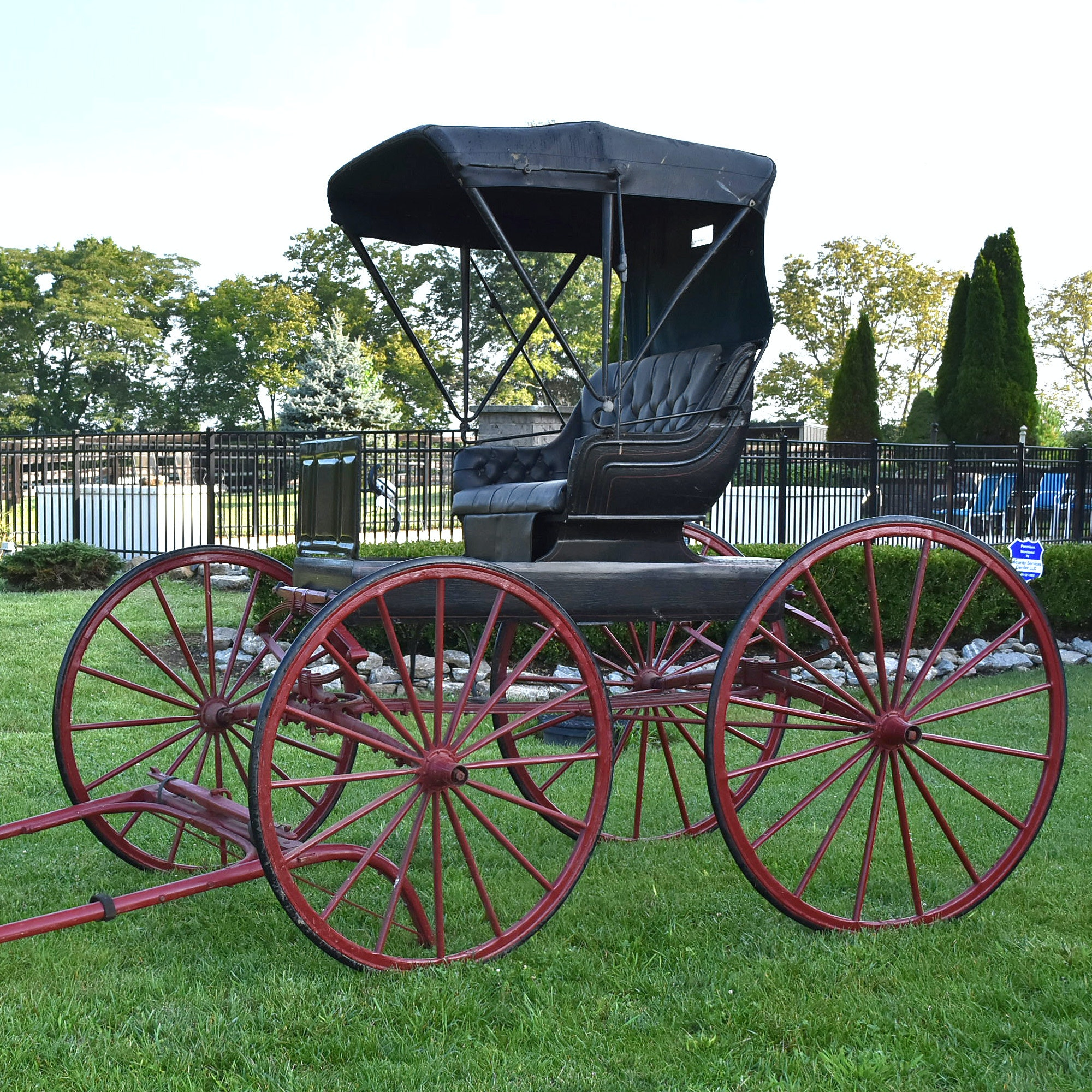 Late 19th Century Red and Black Horse Drawn Buggy