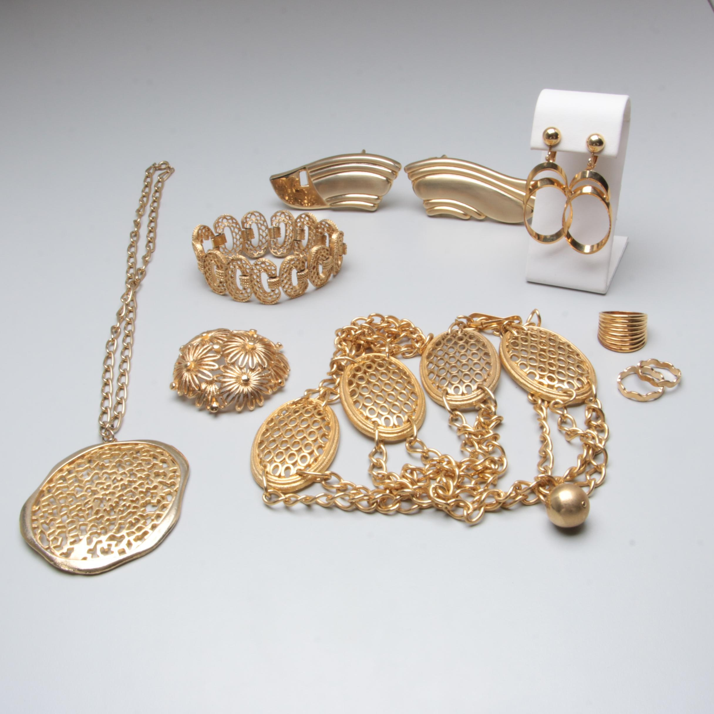 Gold Tone Jewelry Assortment Including Monet, Trifari and Milor