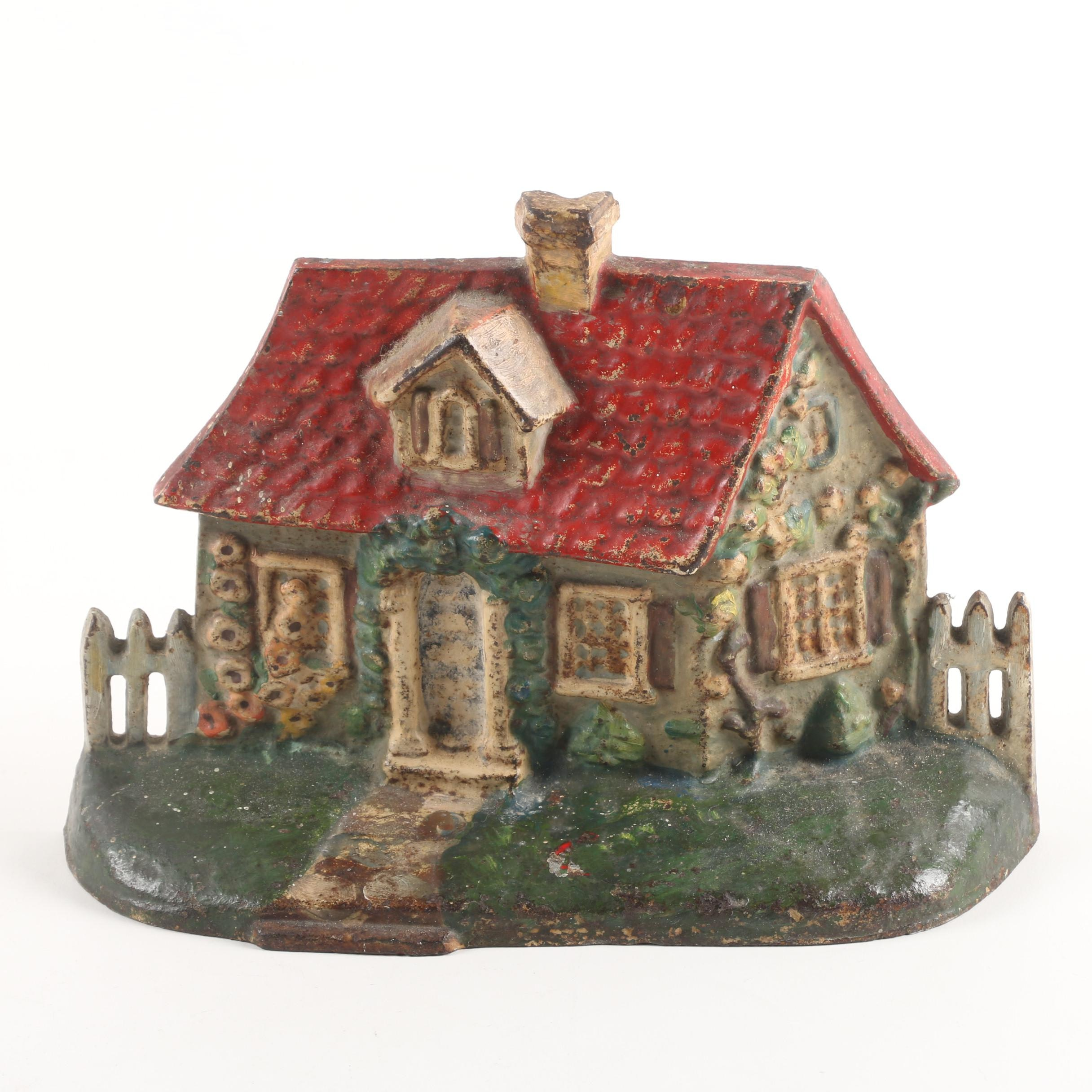 Vintage Cast Iron Cottage Doorstop