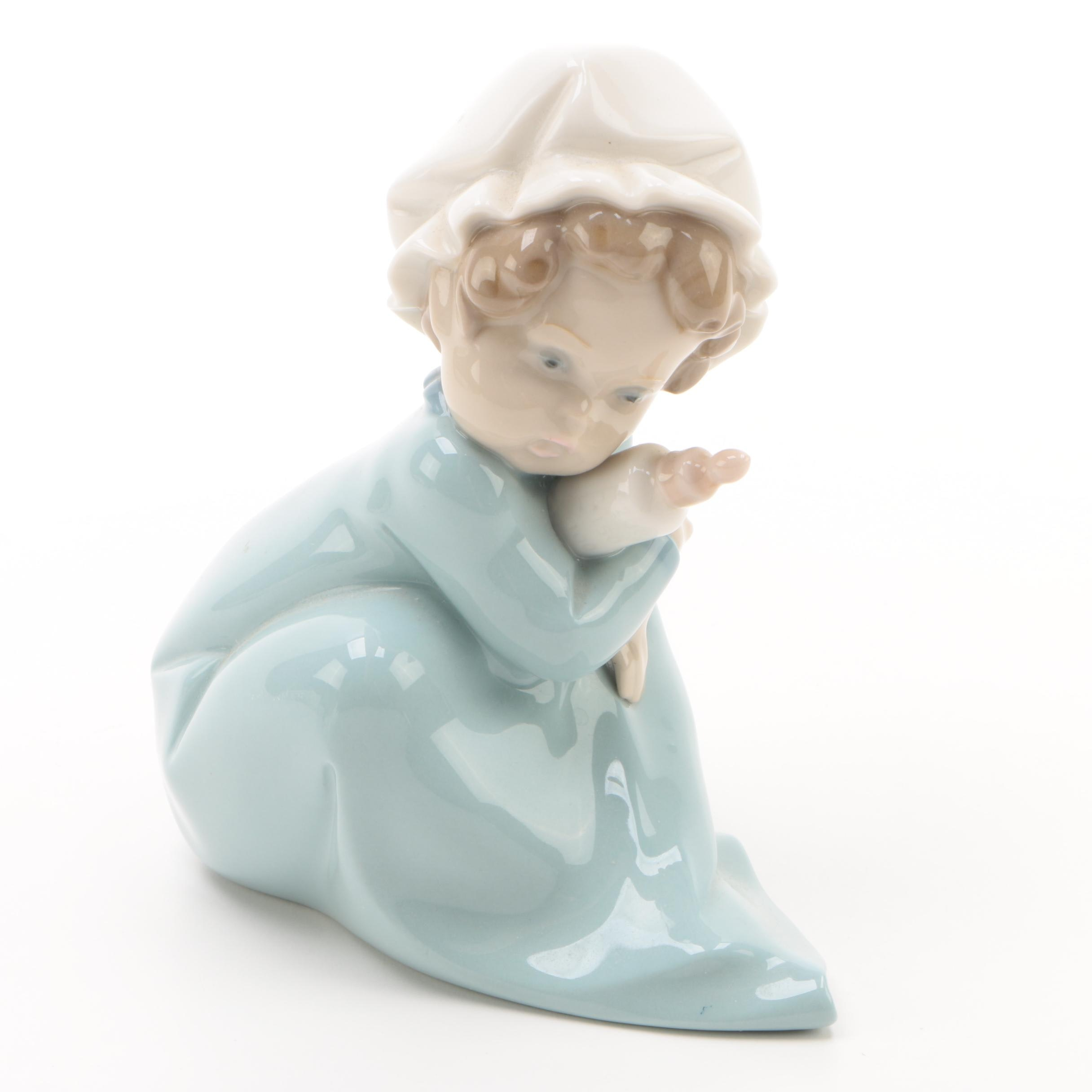 "1980 Lladró ""Holding the Bottle"" Porcelain Figurine"