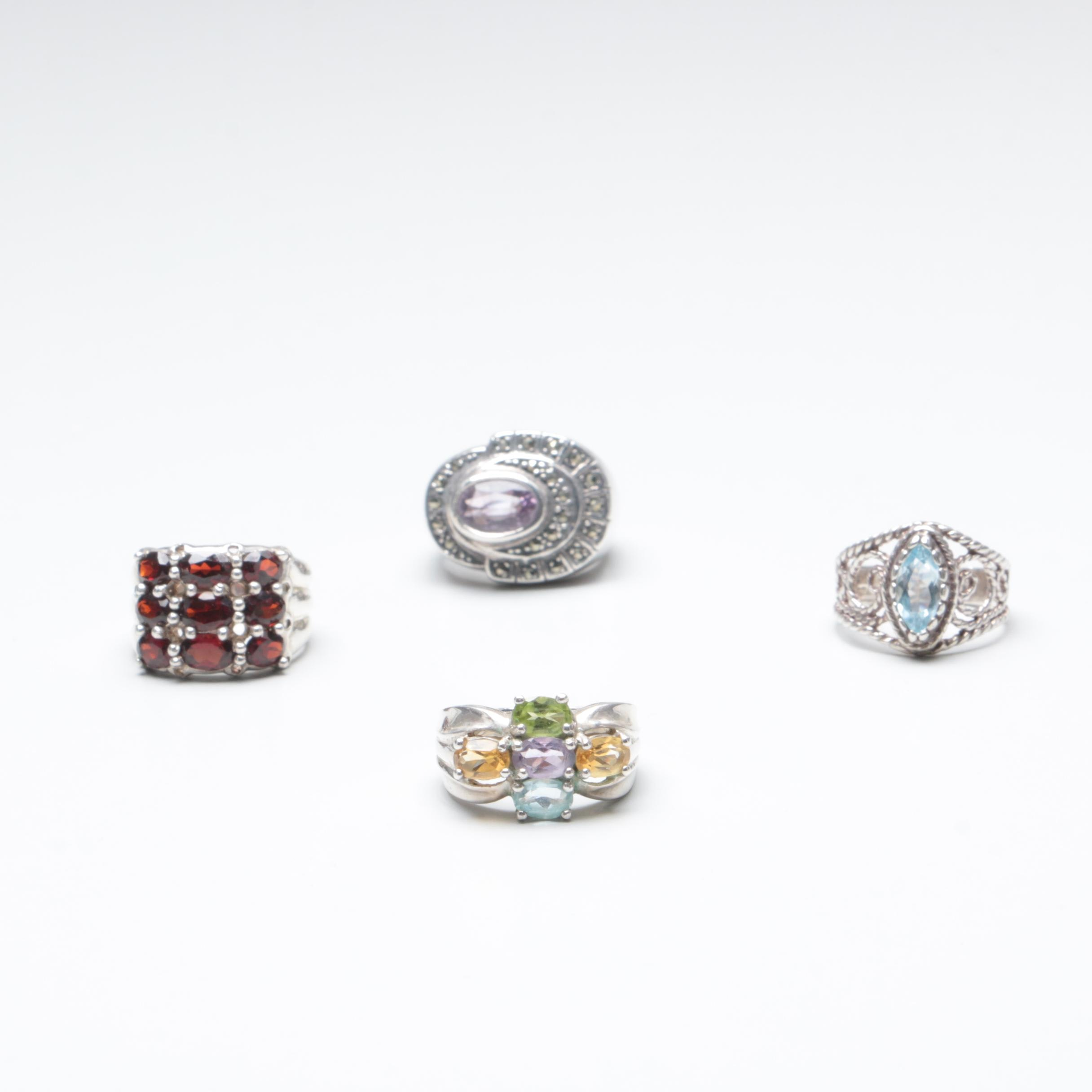 Sterling Silver Ring Selection with Garnet, Blue Topaz, and Peridot