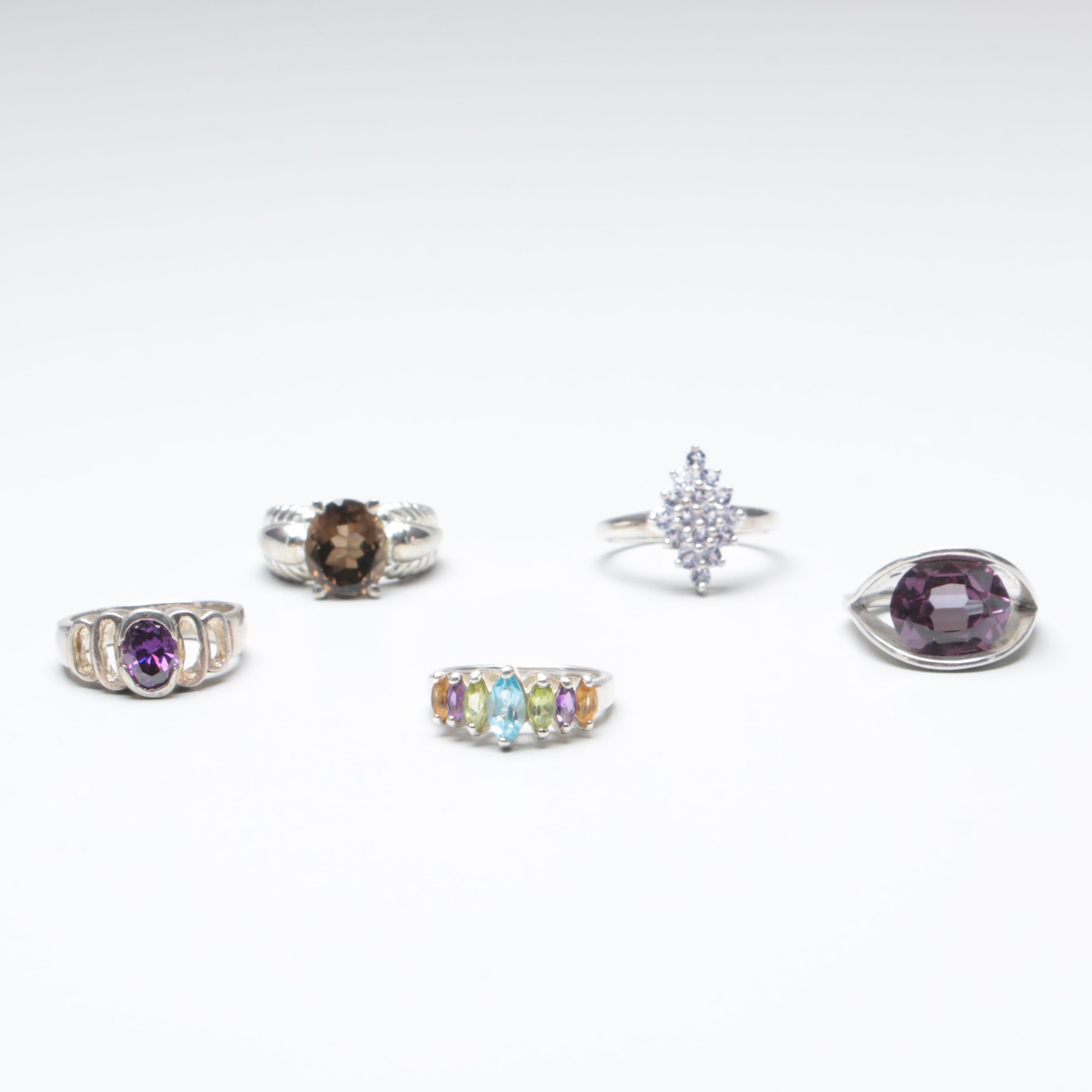Sterling Silver Rings Including Peridot, Blue Topaz, and Amethyst