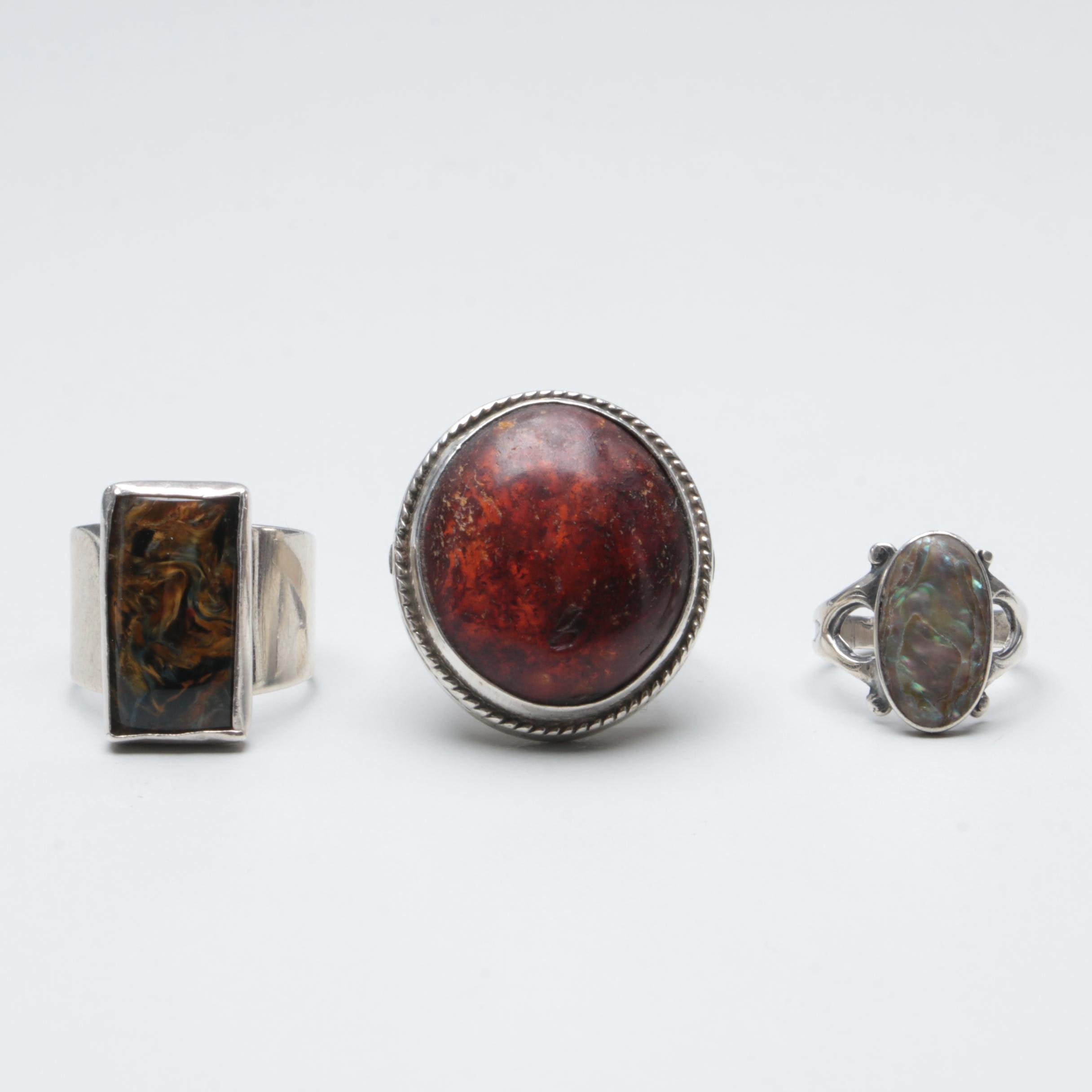 Sterling Silver Rings Including Amber, Tiger's Eye, and Abalone