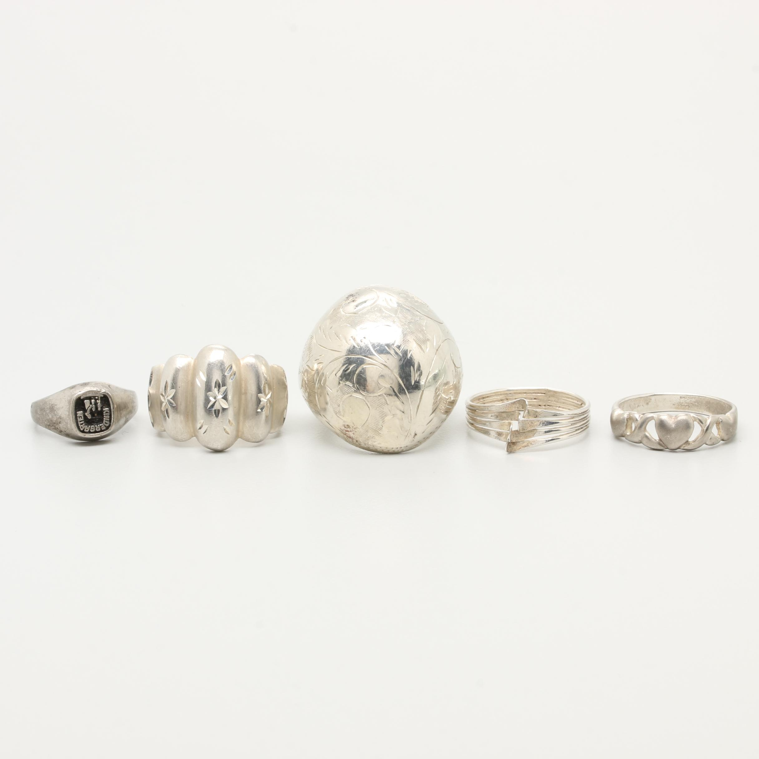 Sterling Silver Ring Assortment Including Heart and Floral Motifs