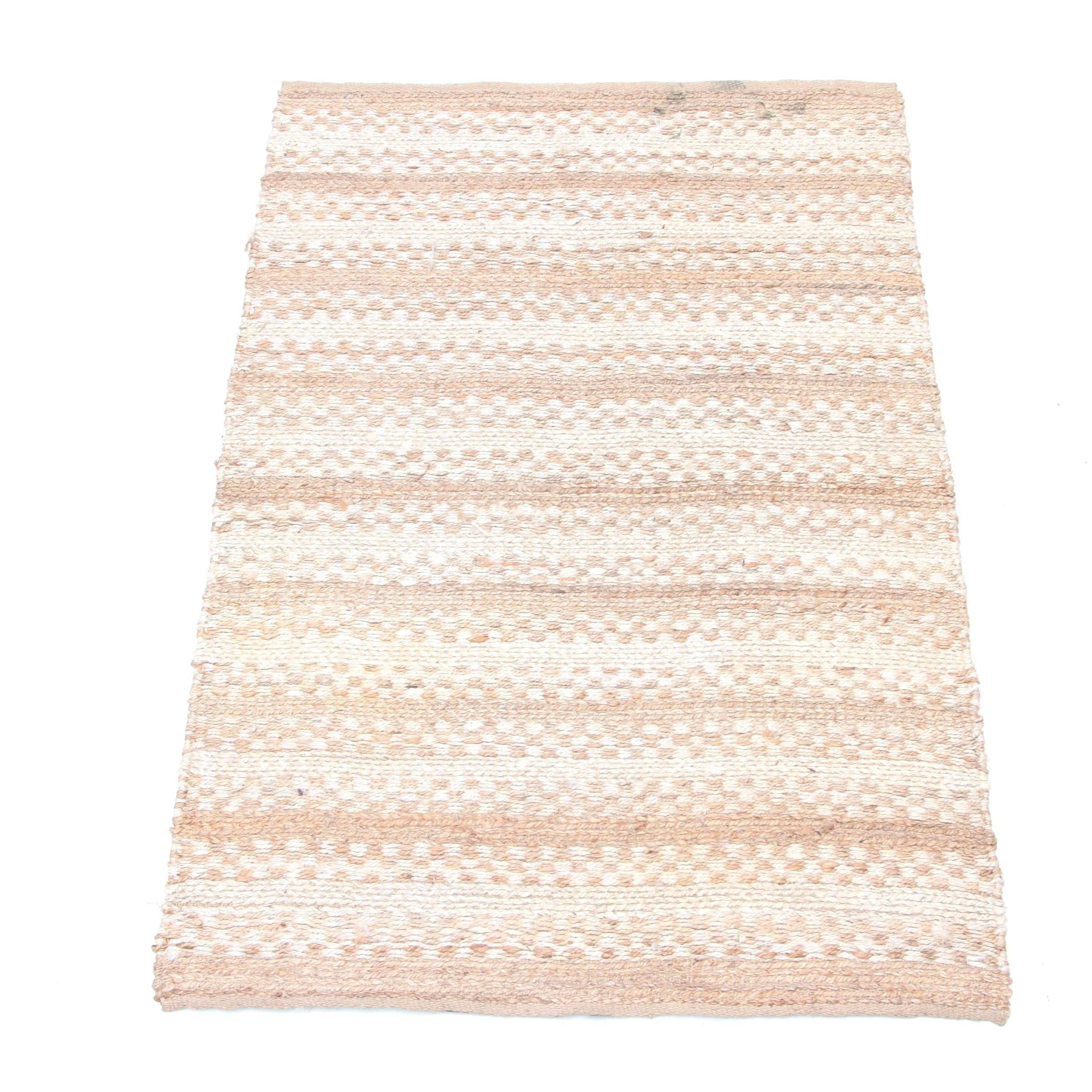 Woven and Tufted Handmade Jute Area Rug by Woodstock