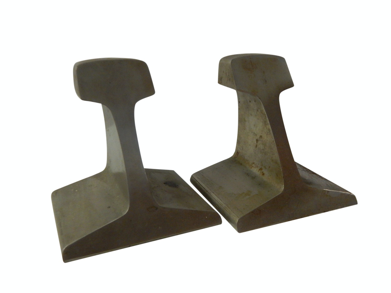 Abstract Steel Bookends After Steel Rails