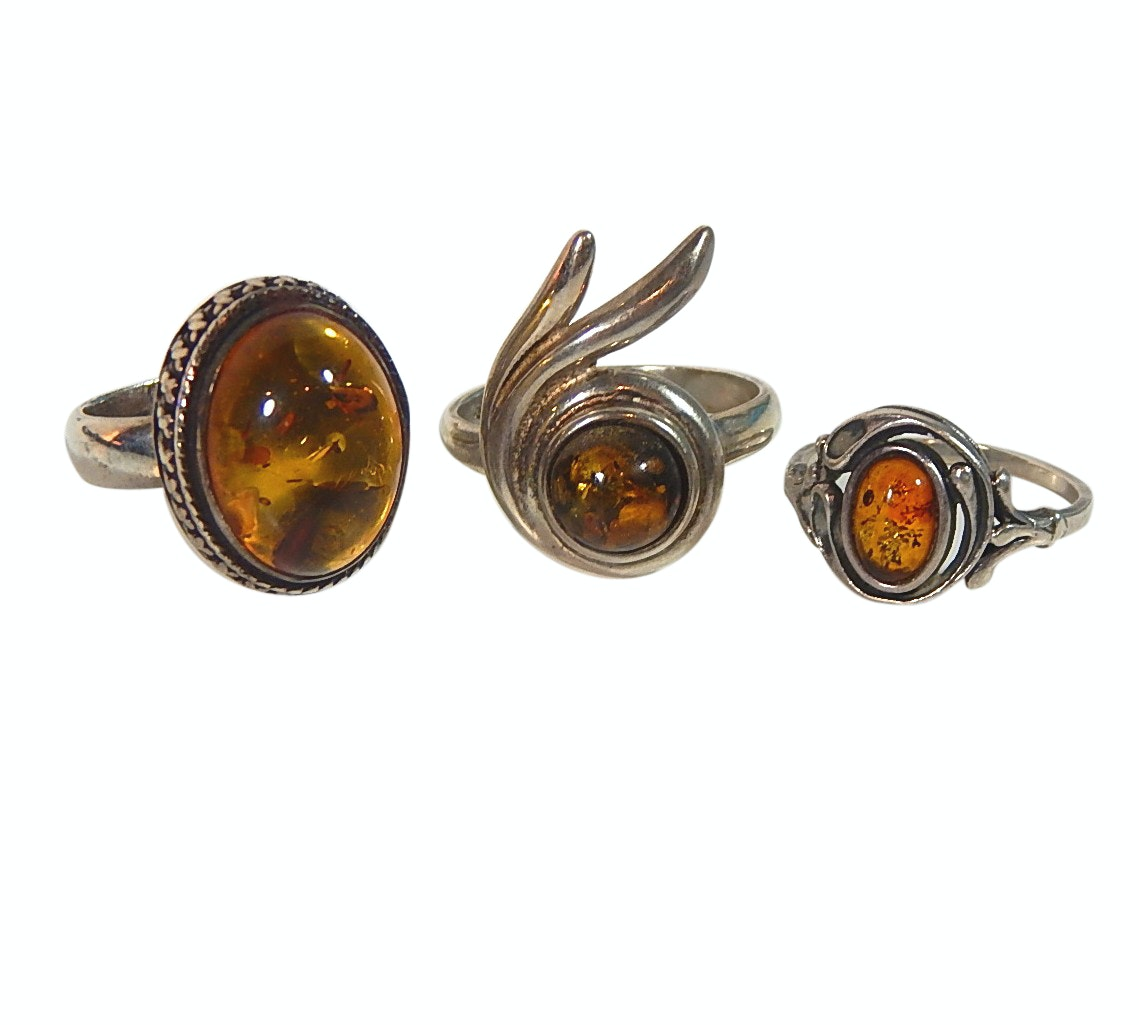 Three Sterling Silver Rings with Amber Stones