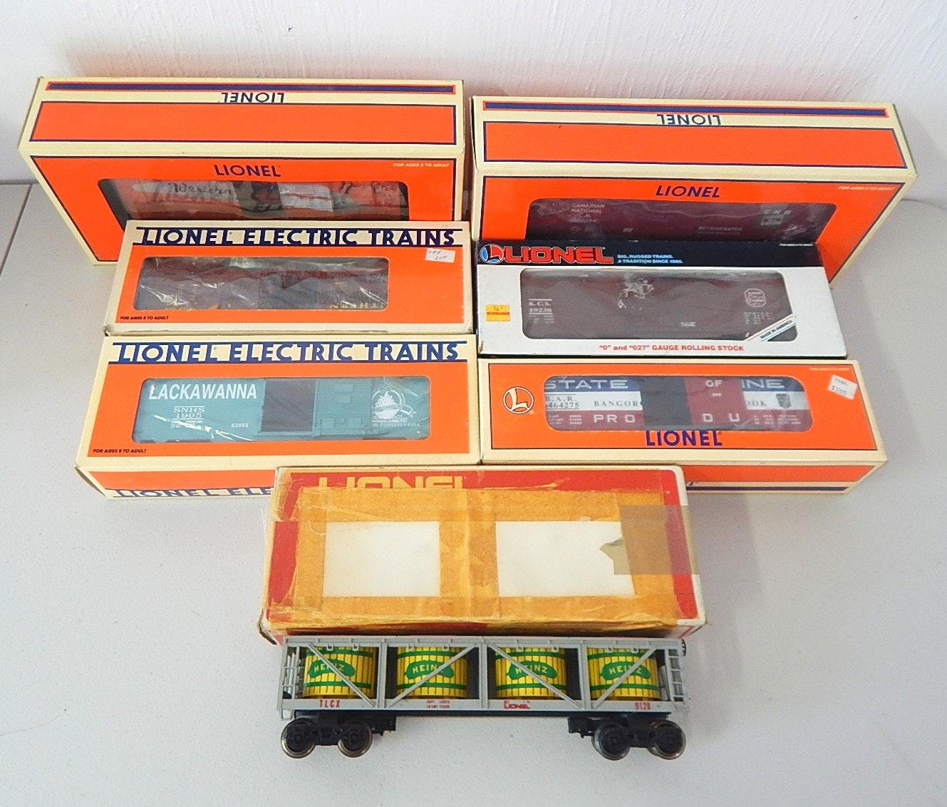 Seven Vintage Lionel O-Gauge Train Cars with Boxes