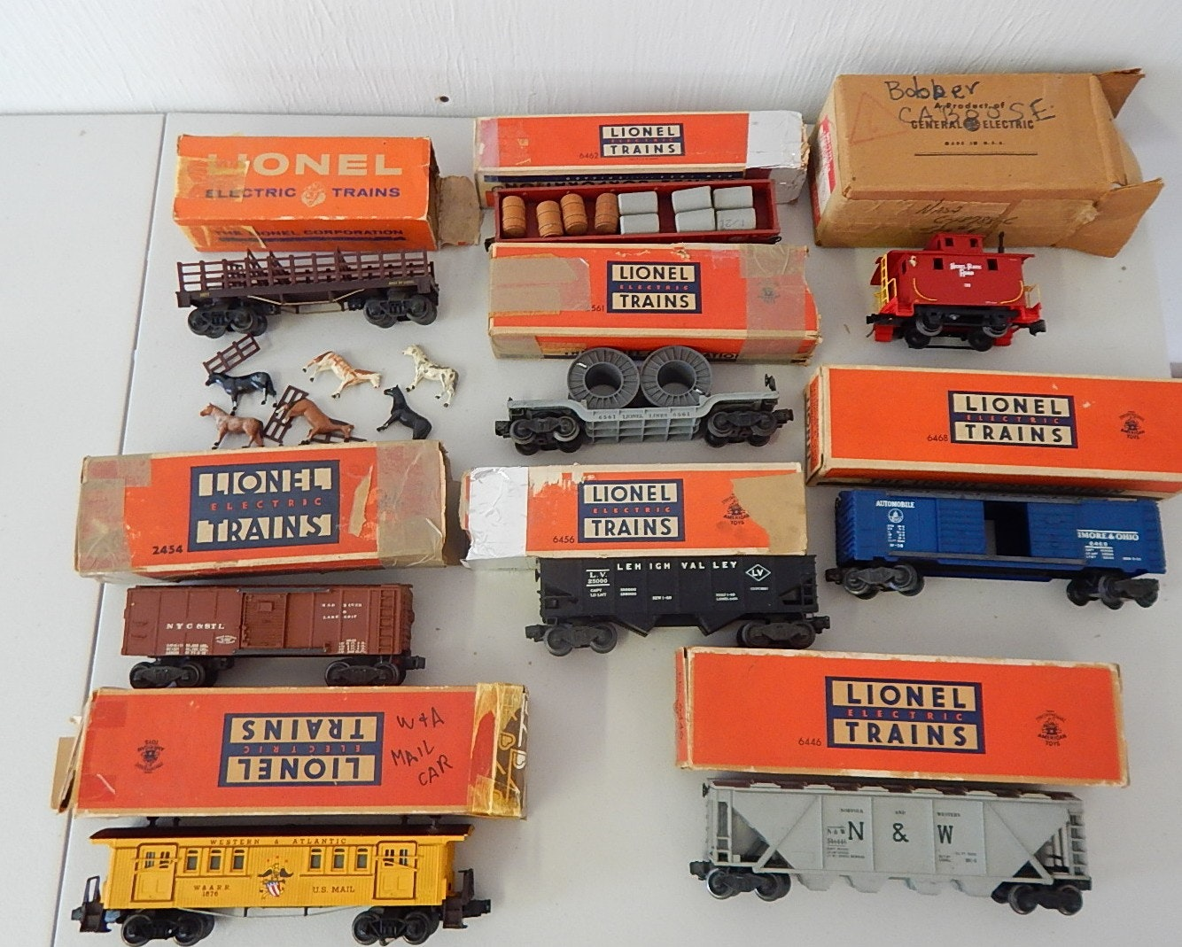 Nine Vintage Lionel O-Gauge Train Cars with Original Boxes