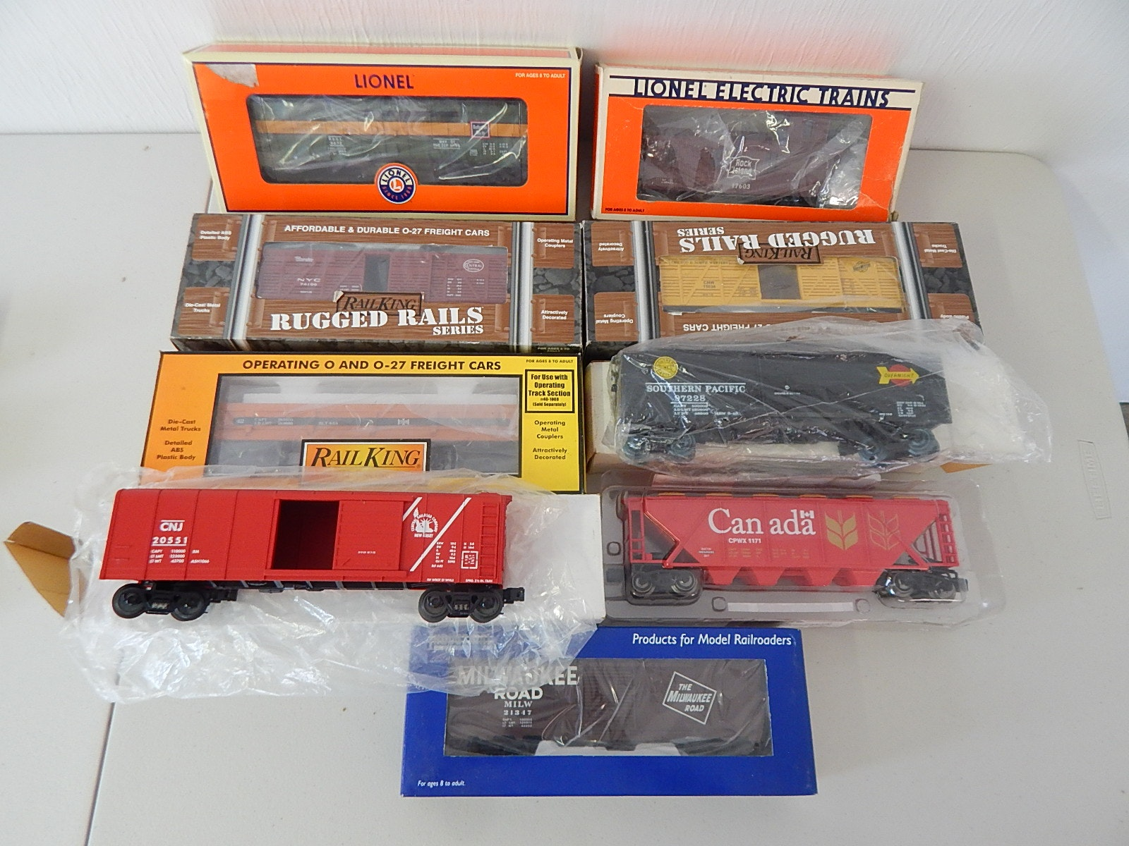 Nine O-Gauge Train Cars with Lionel, Rail King, Industrial
