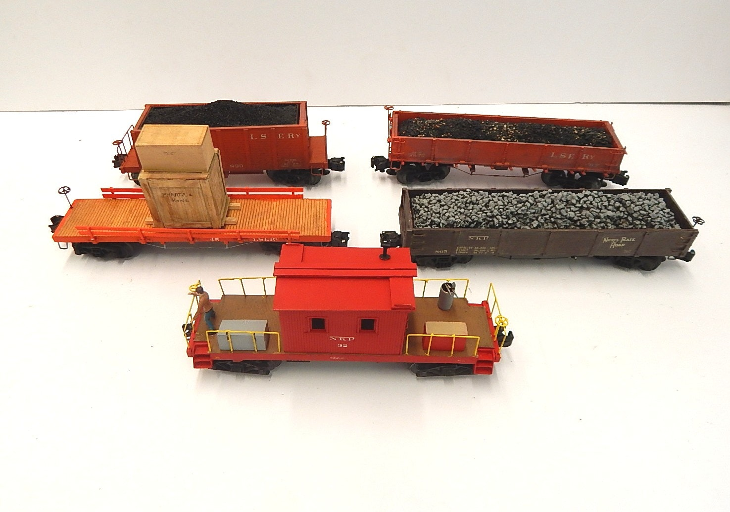 Five Vintage O-Gauge Train Cars with Tenders, Caboose