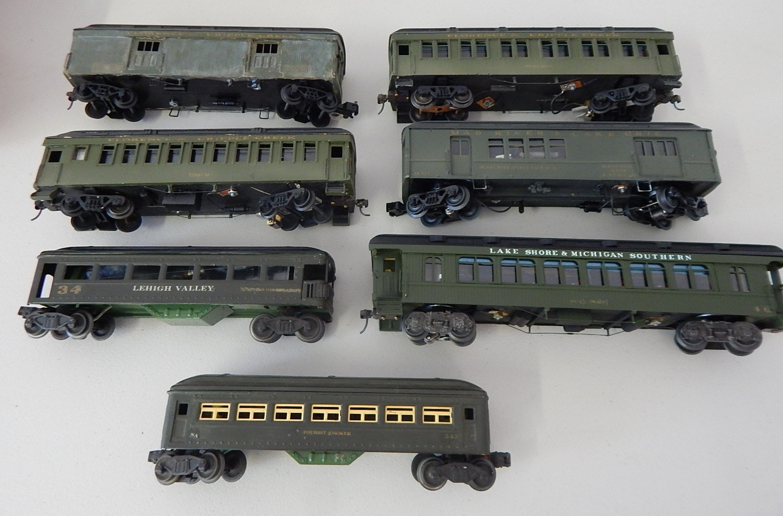Seven Vintage O-Gauge Green Train Cars, Lehigh Valley, Mad River and Lake Erie