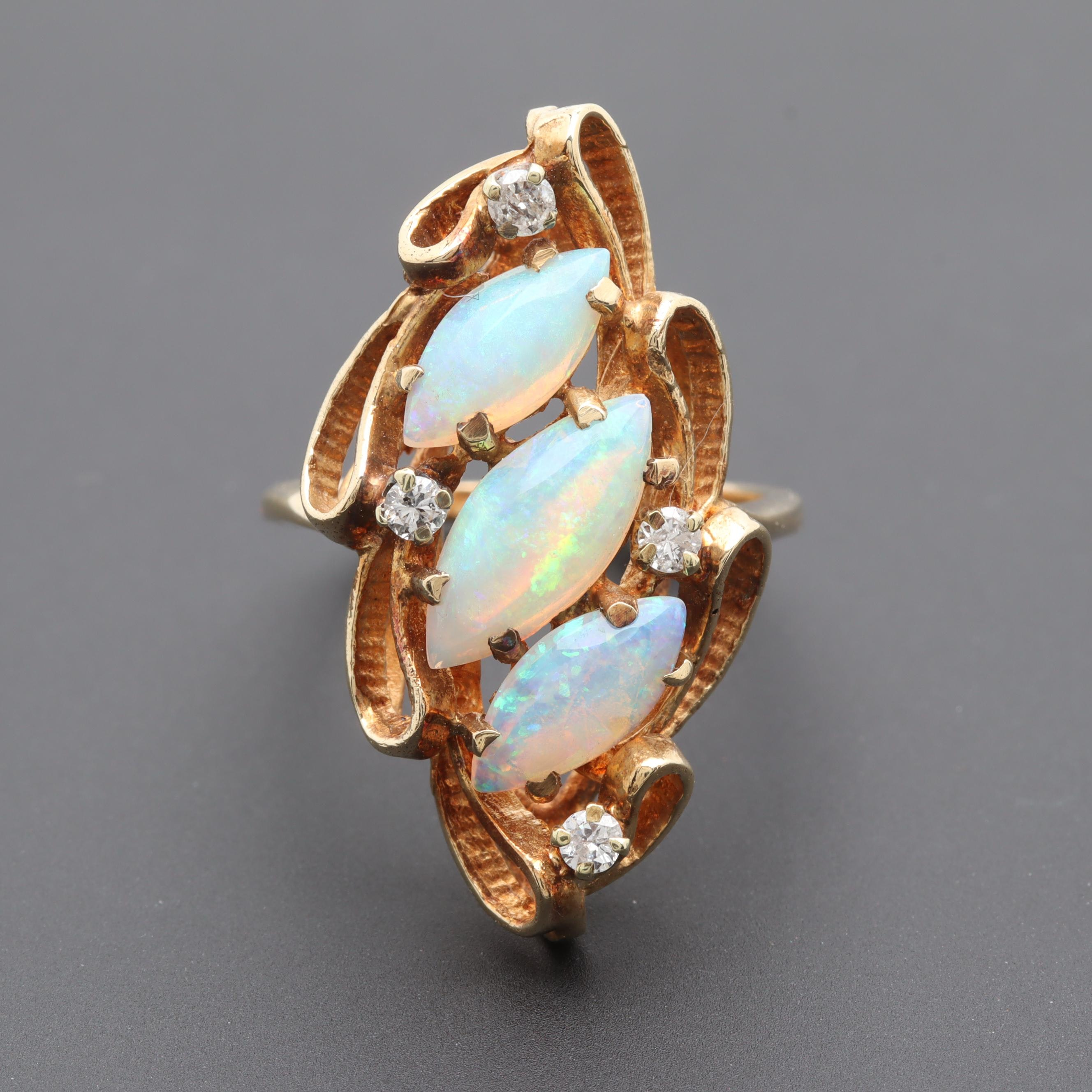 Circa 1960s - 1970s 14K Yellow Gold Opal and Diamond Ring