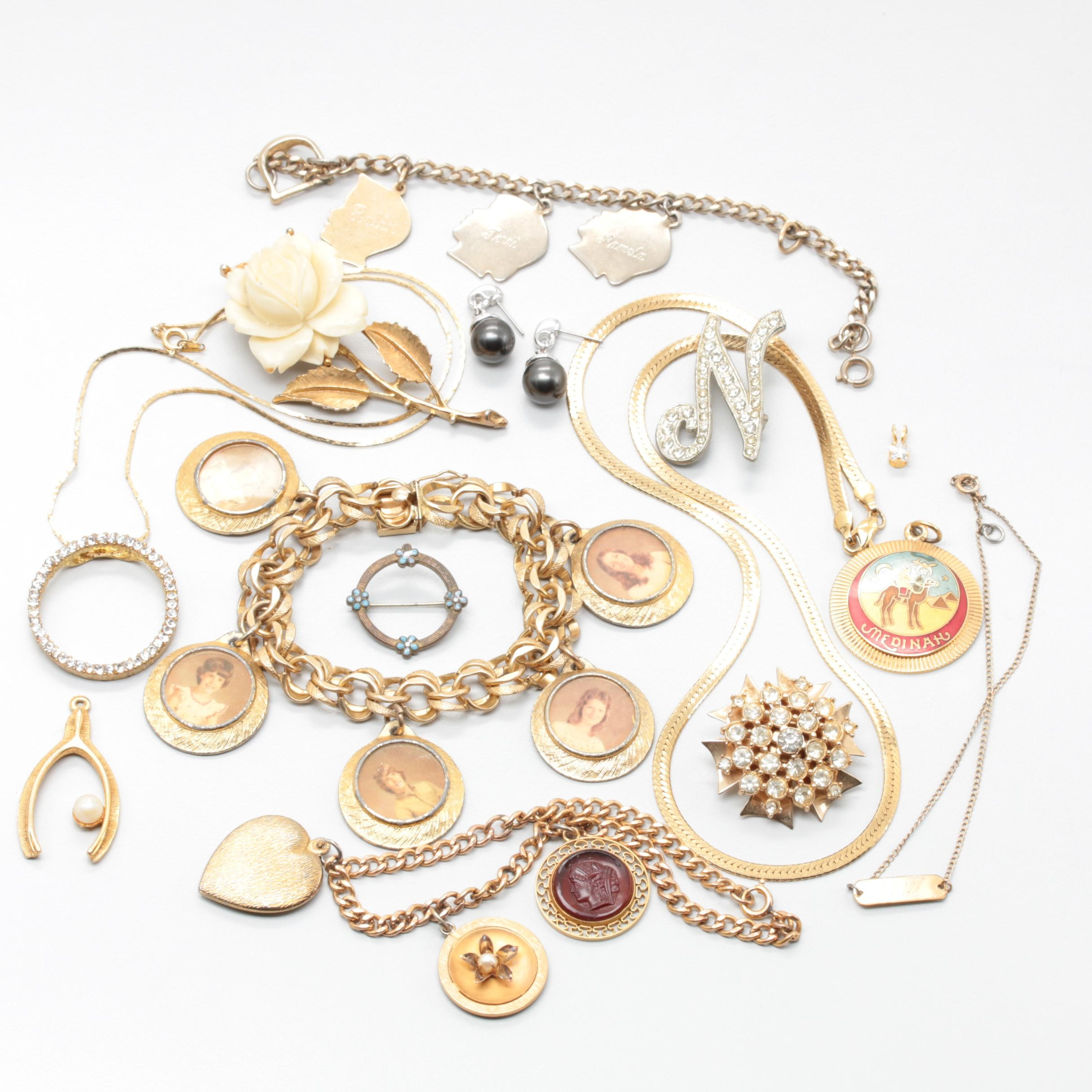Gold Tone Jewelry Assortment Including Foilbacks, Enamel, and Plastic