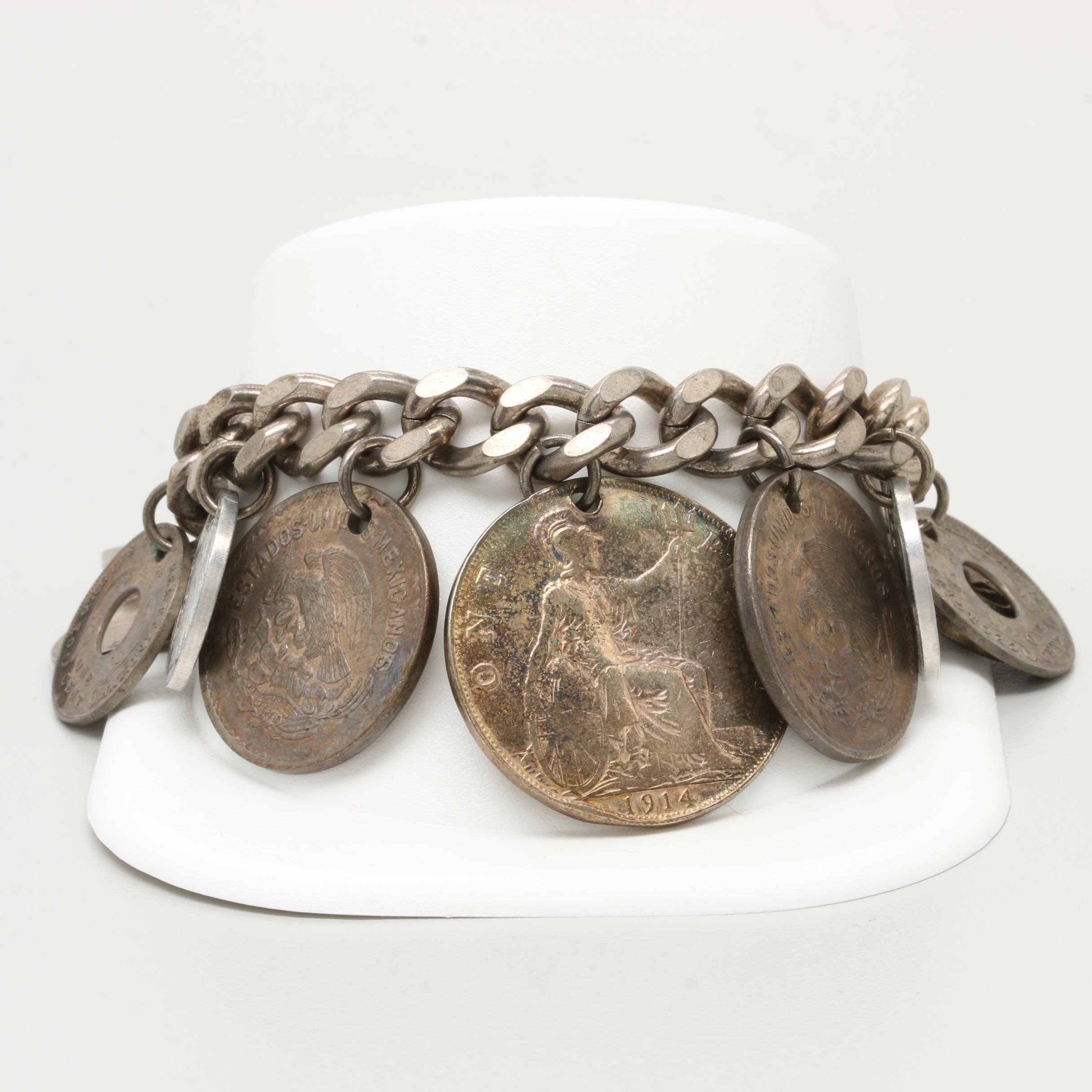Curb Link Charm Bracelet With Assorted Foreign Coins