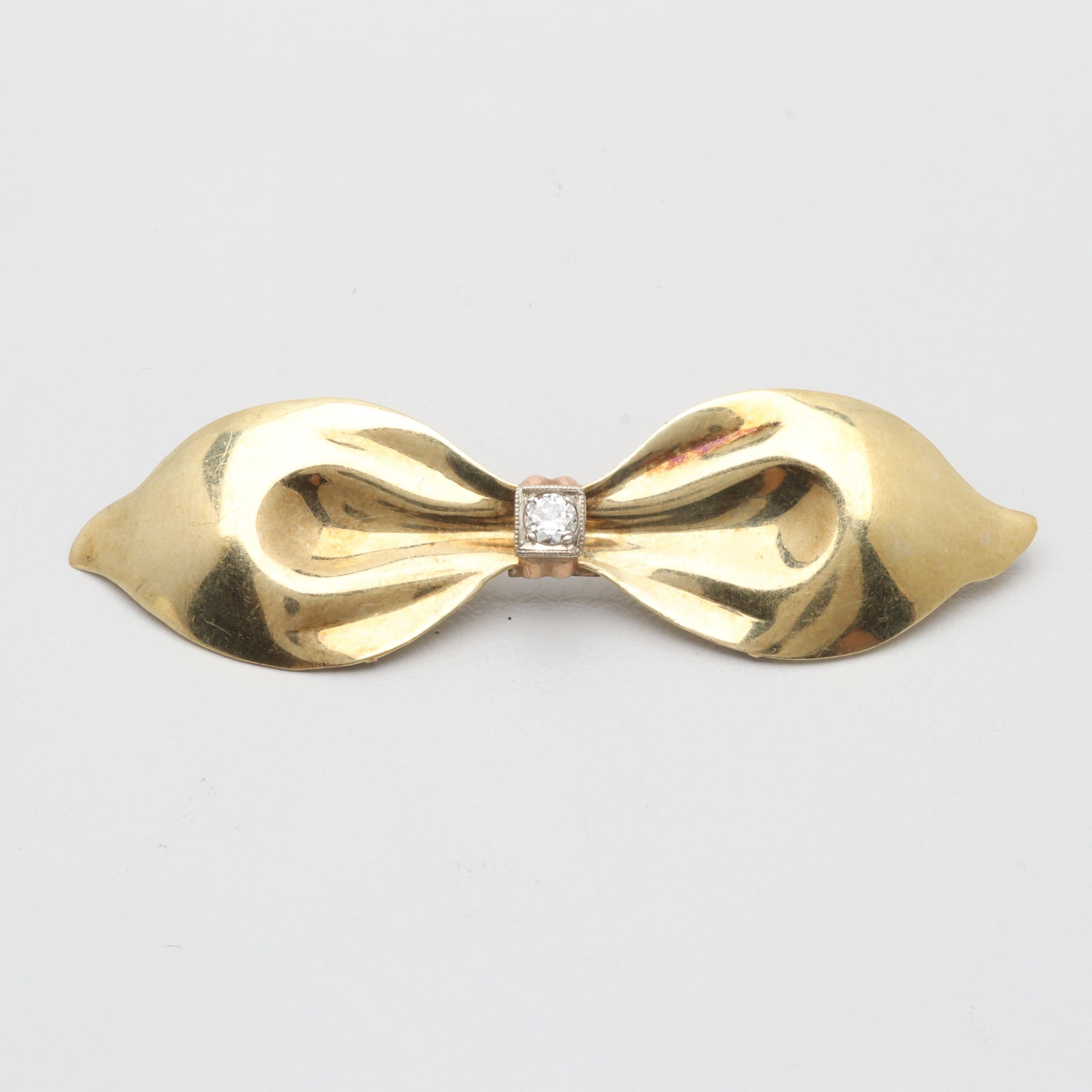 Circa 1940s 14K Yellow Gold Diamond Bow Brooch