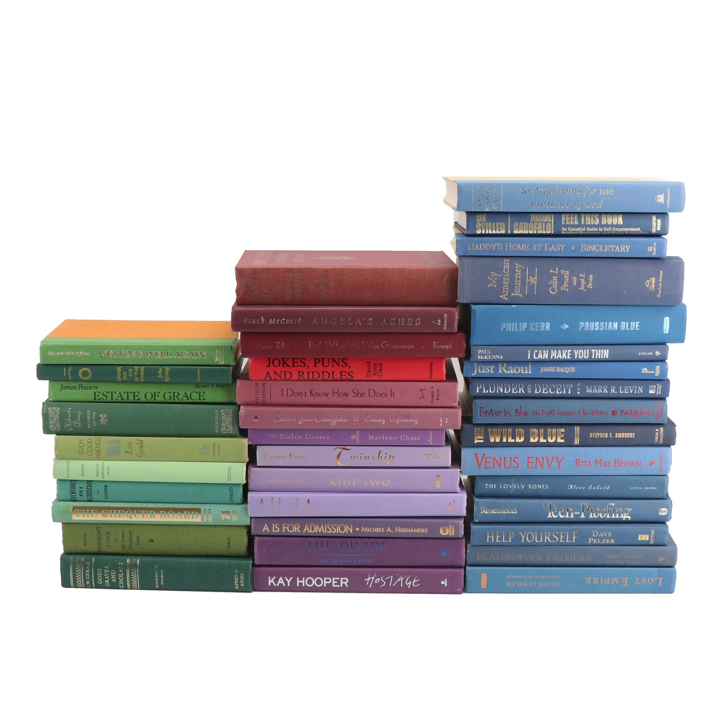 Decorative Stacks of Green, Red, Purple, and Blue Hardcover Books