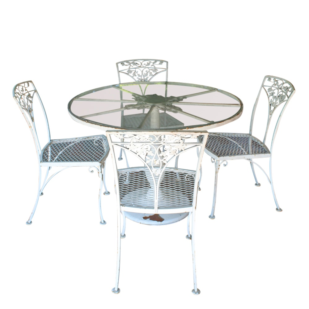 Glass Patio Table and Four Metal Patio Chairs