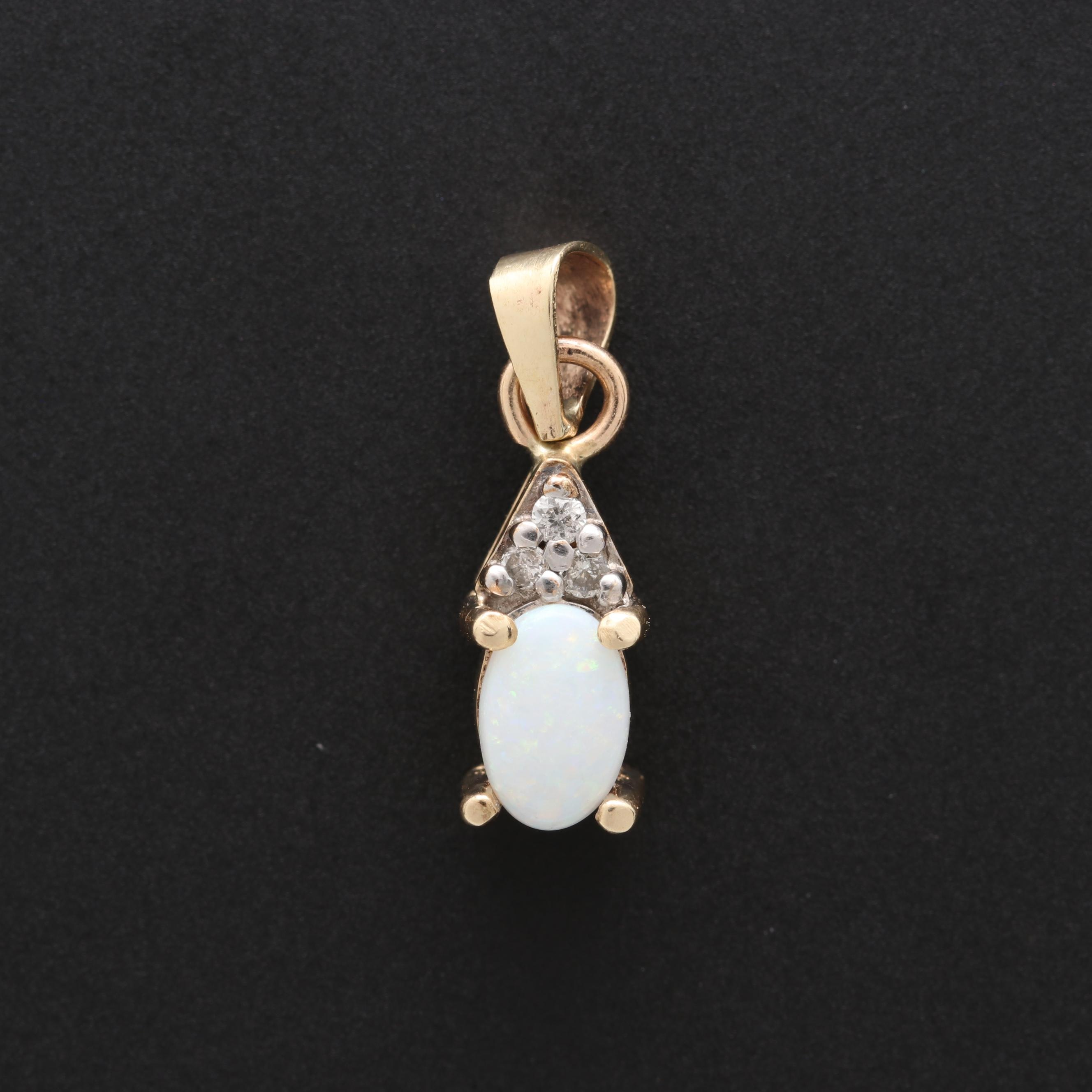 10K Yellow Gold Opal and Diamond Pendant With 14K Yellow Gold Bail