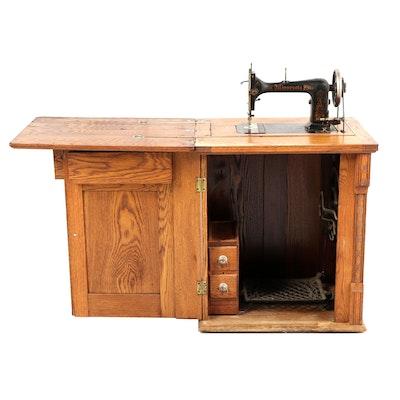Sears-Roebuck Minnesota Model A Sewing Machine in Eastlake Style Oak Cabinet - Antique Singer Treadle Sewing Machine : EBTH