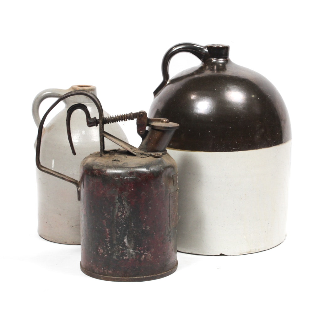 Two Stoneware Jugs and Vintage Gas Can