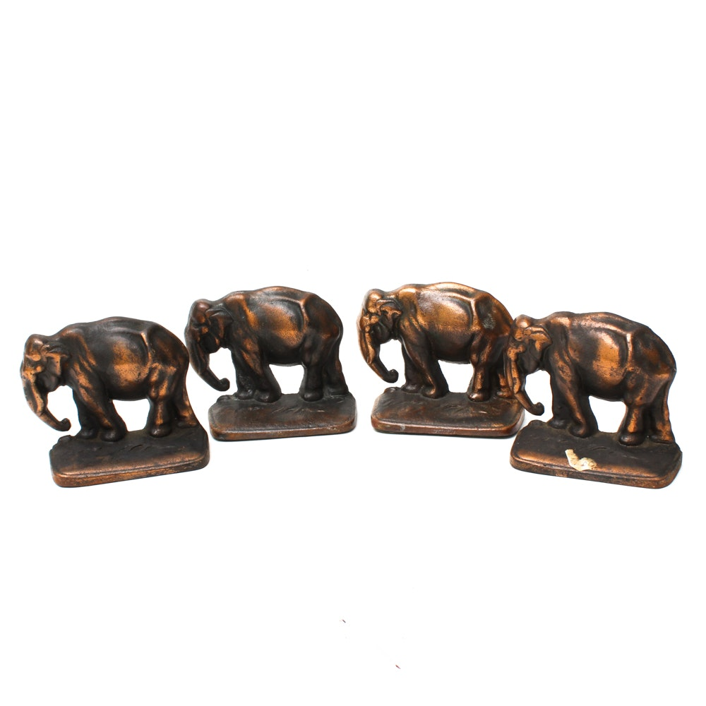 Four Brass Elephant Bookends