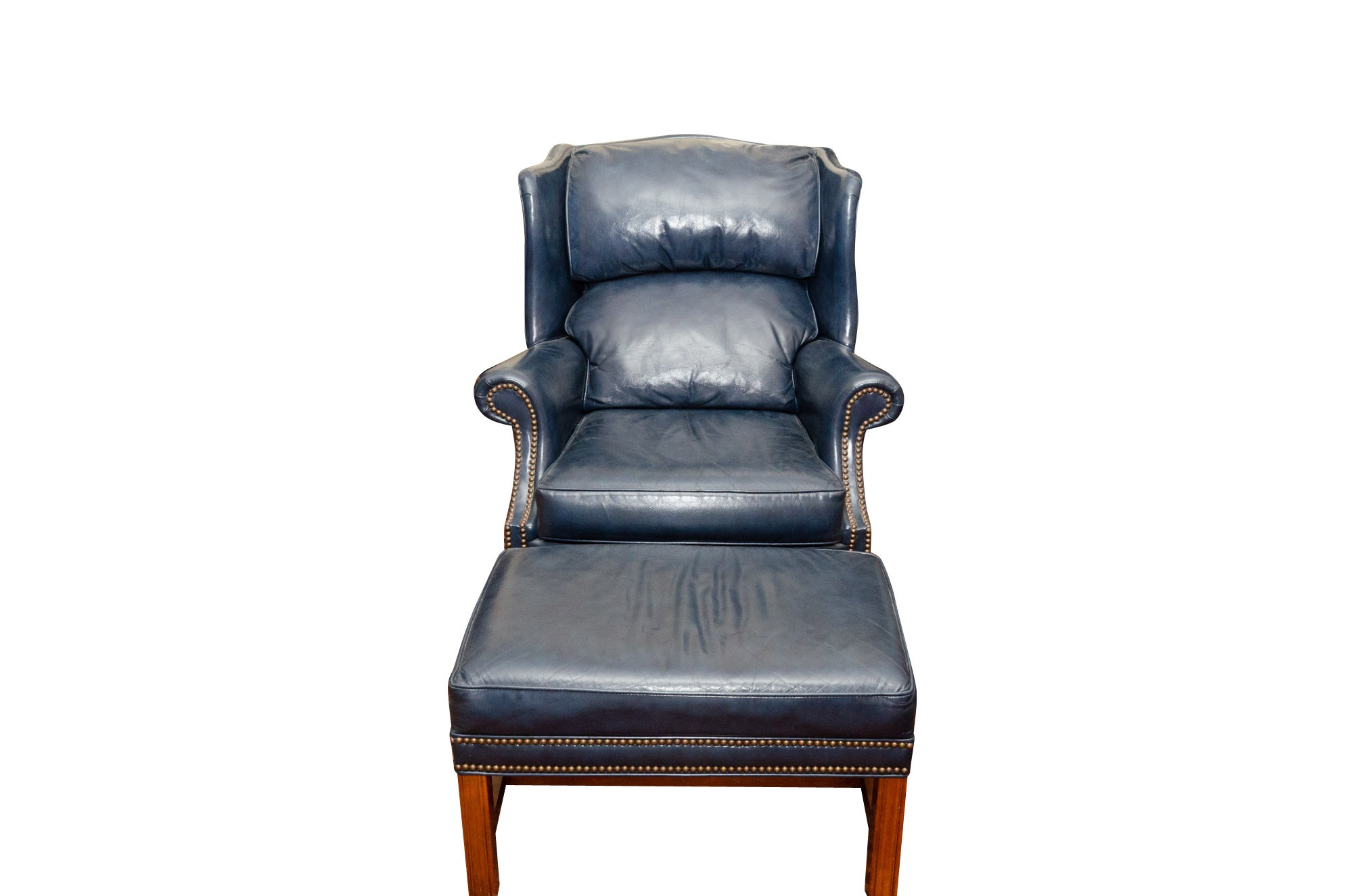 Leather Wingback Armchair And Ottoman By Leugers ...