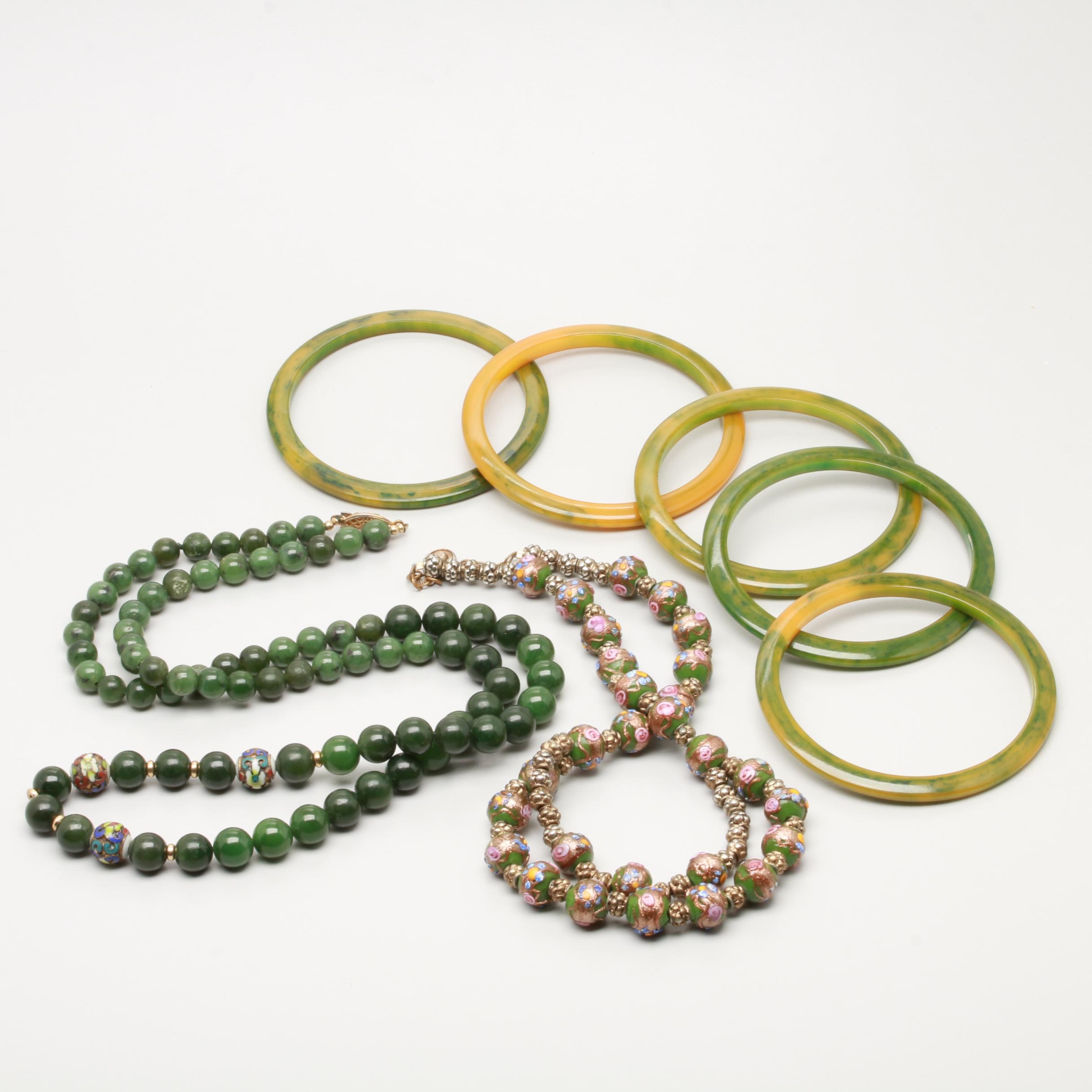 Assortment of Costume Jewelry Including Bakelite, Nephrite, and Glass
