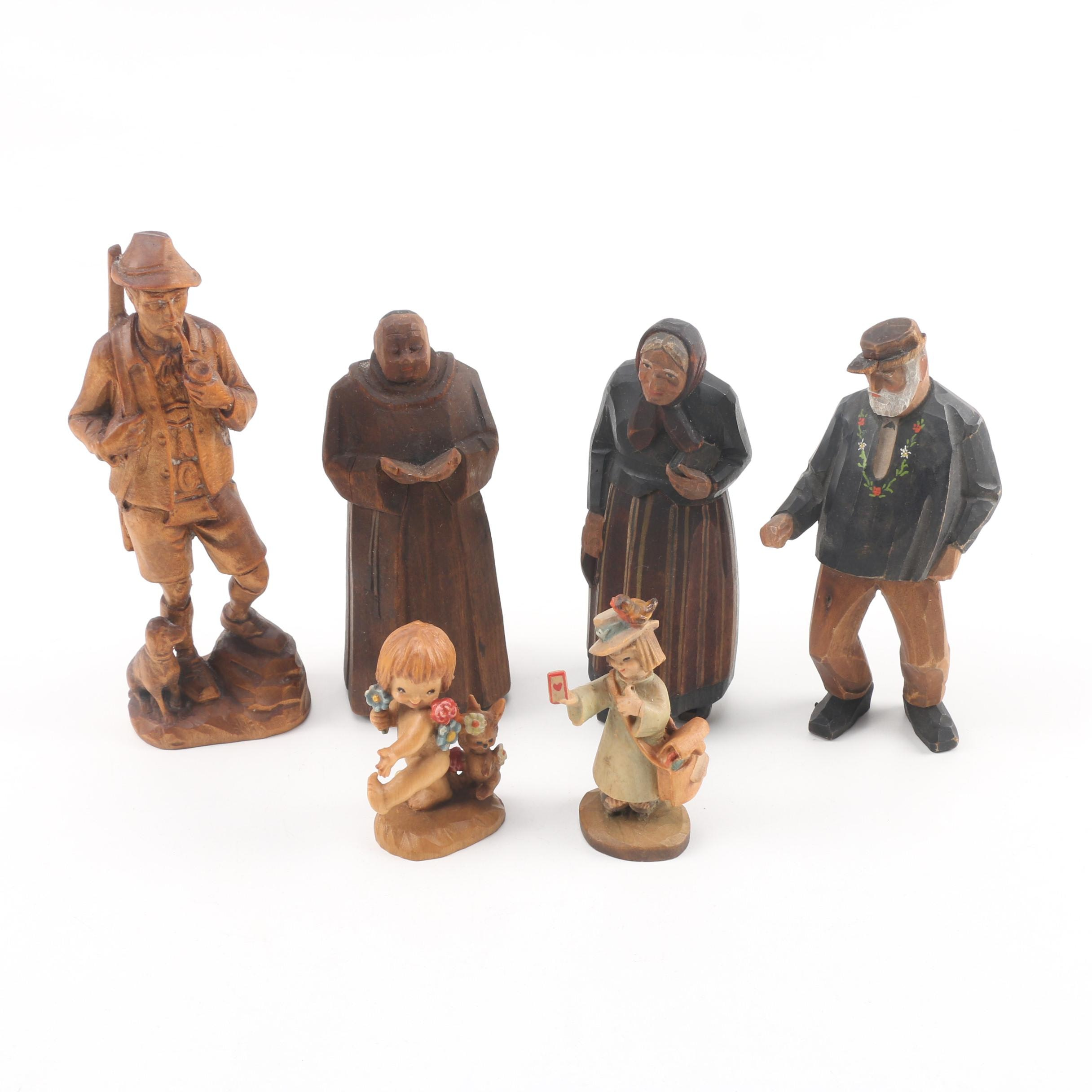 Carved Wood Figurines featuring Anri