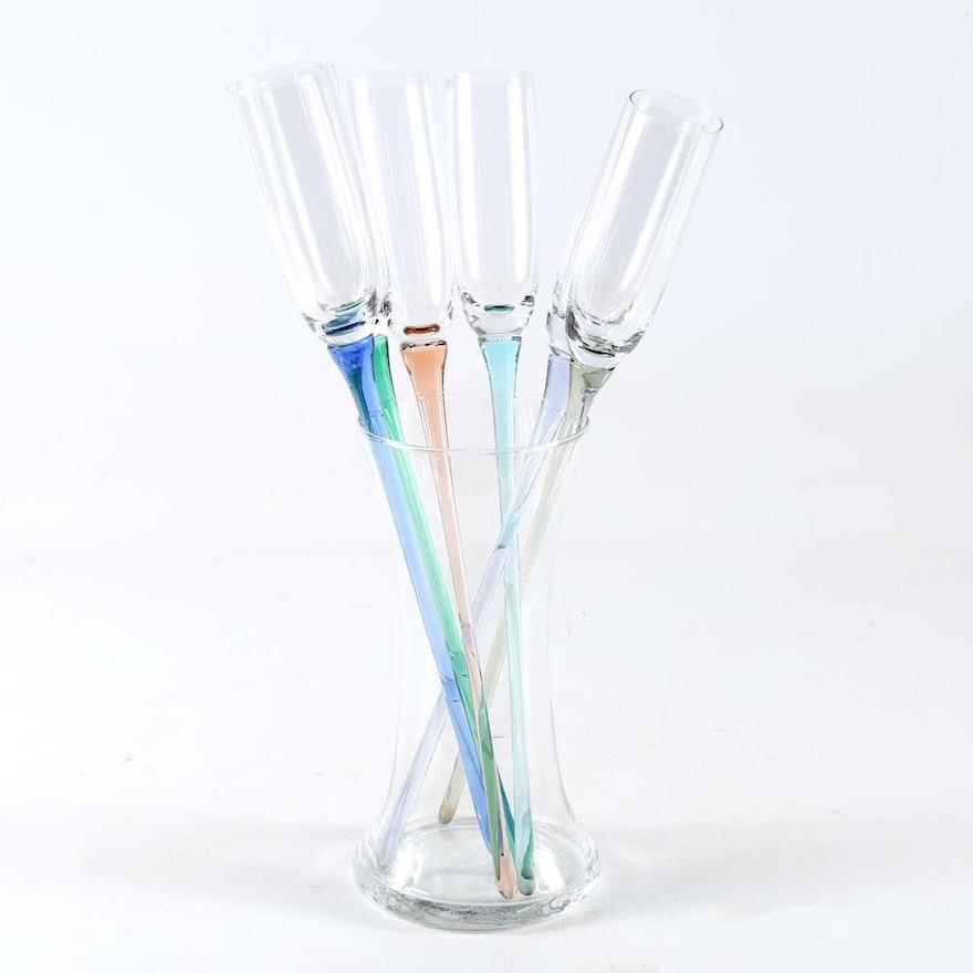 Long Stemmed Champagne Flutes In Vase Ebth