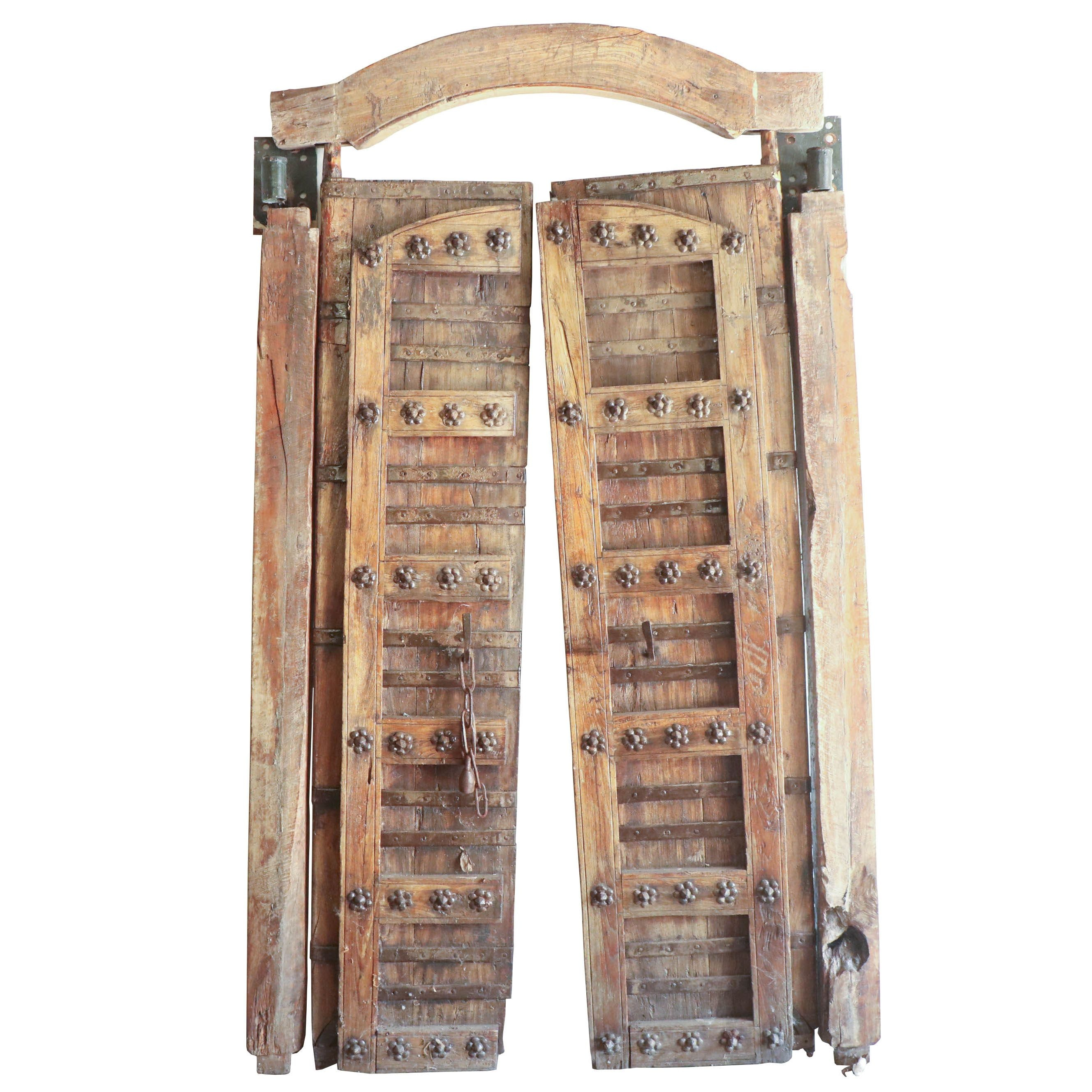 Western Saloon Style Wooden Doors with Floral Embellishments