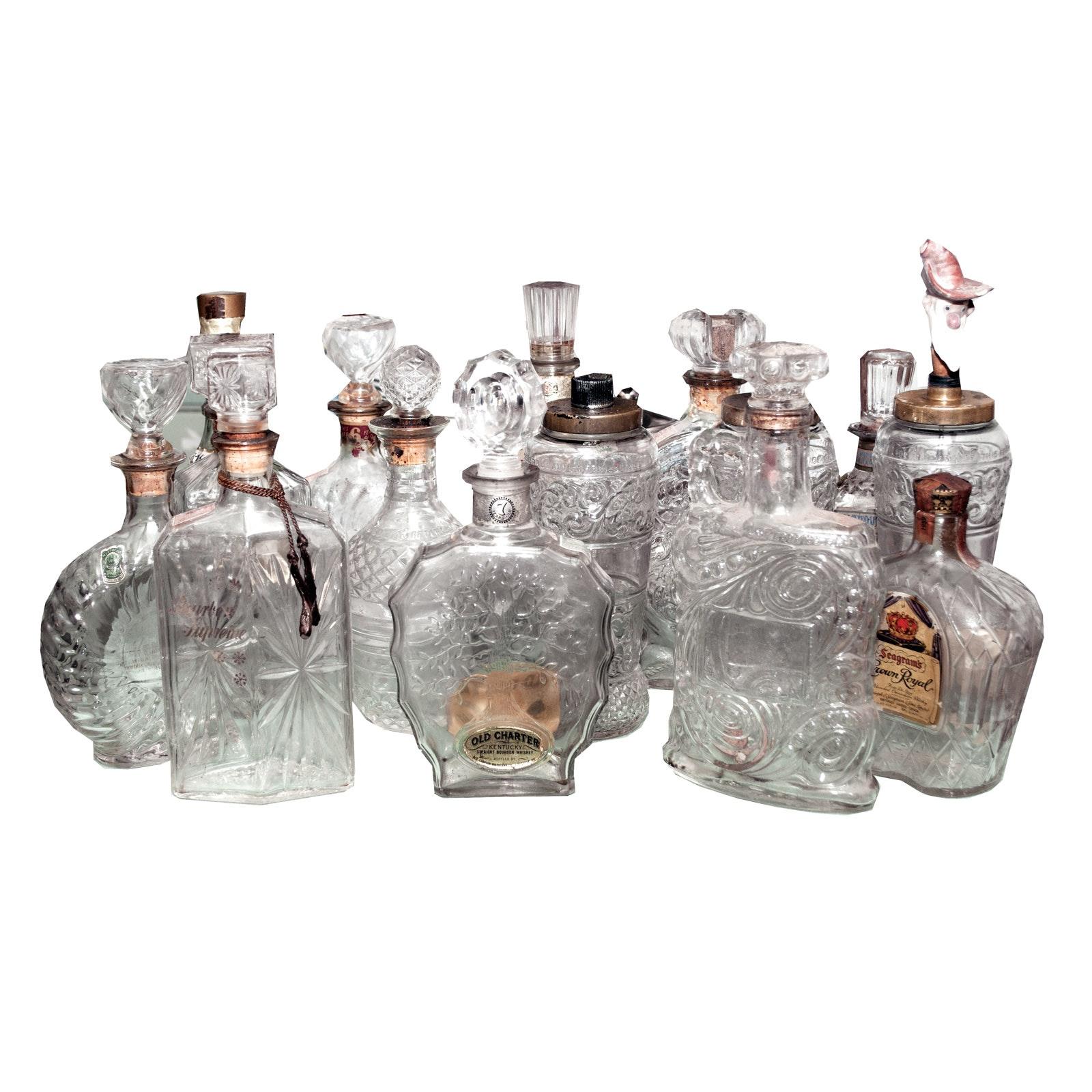 Fifteen Vintage Impressed Glass Liquor Bottles