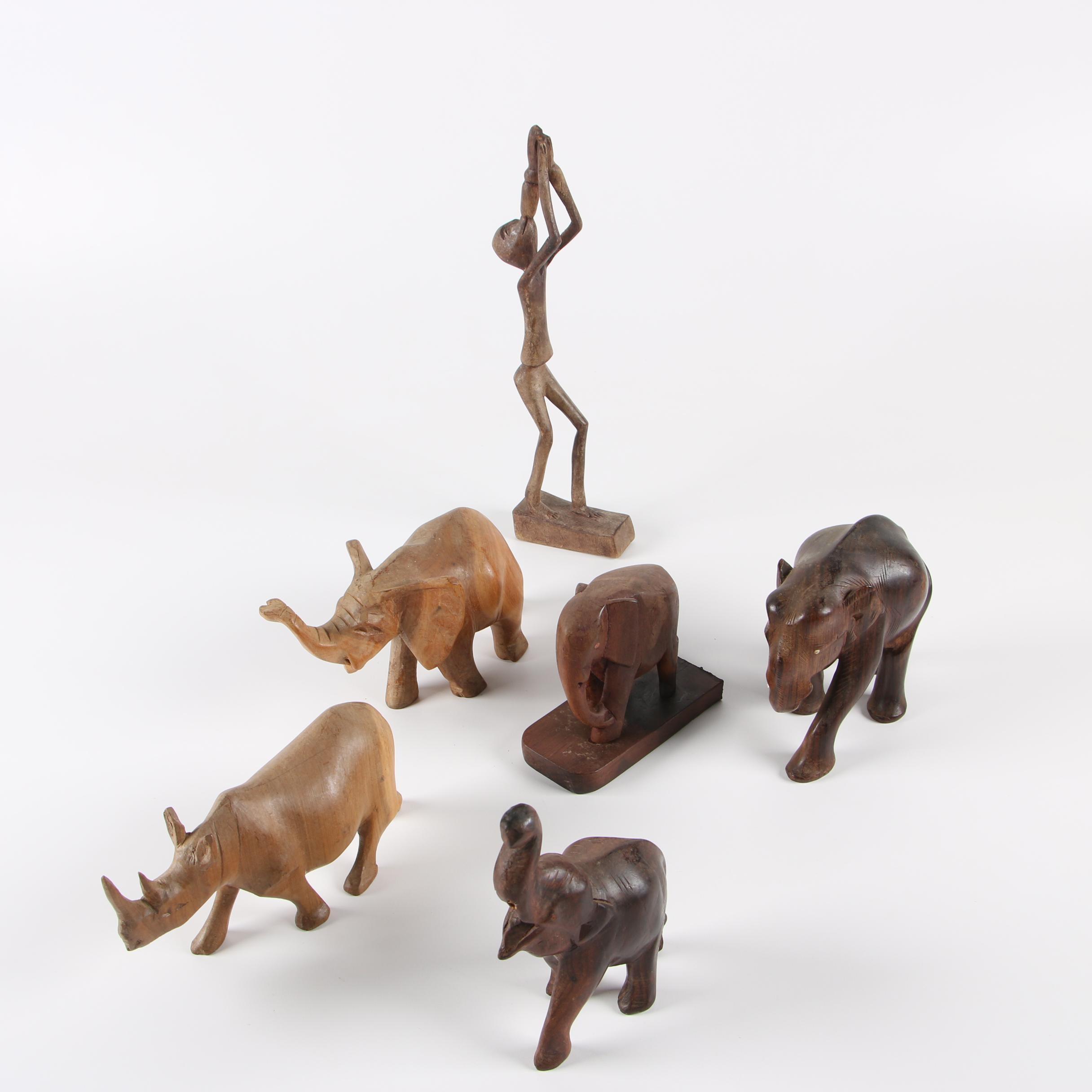Carved Wood Elephants, Rhinoceros and Figure