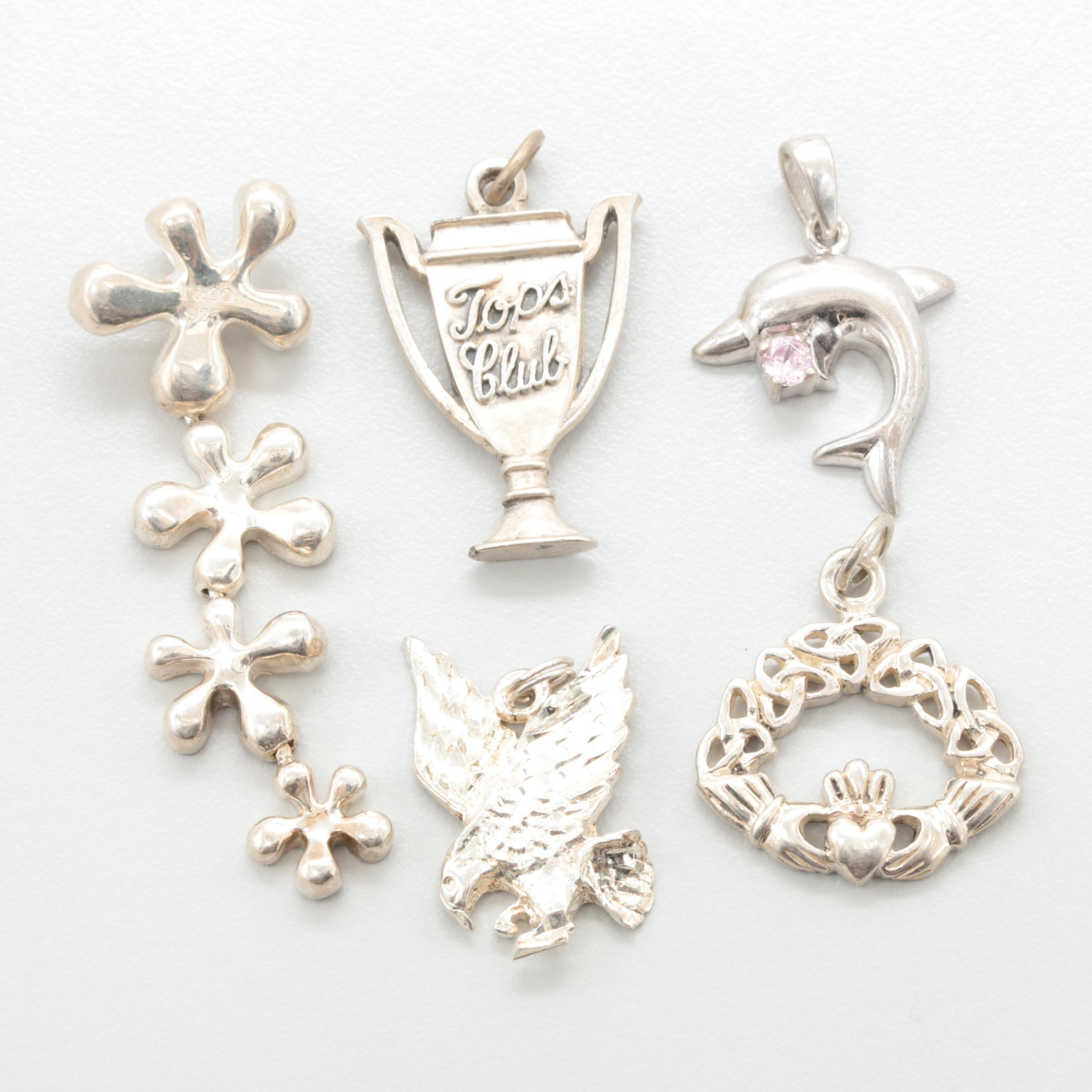 Sterling Silver Charm Assortment Featuring a Dolphin, Eagle, Trophy and Claddagh