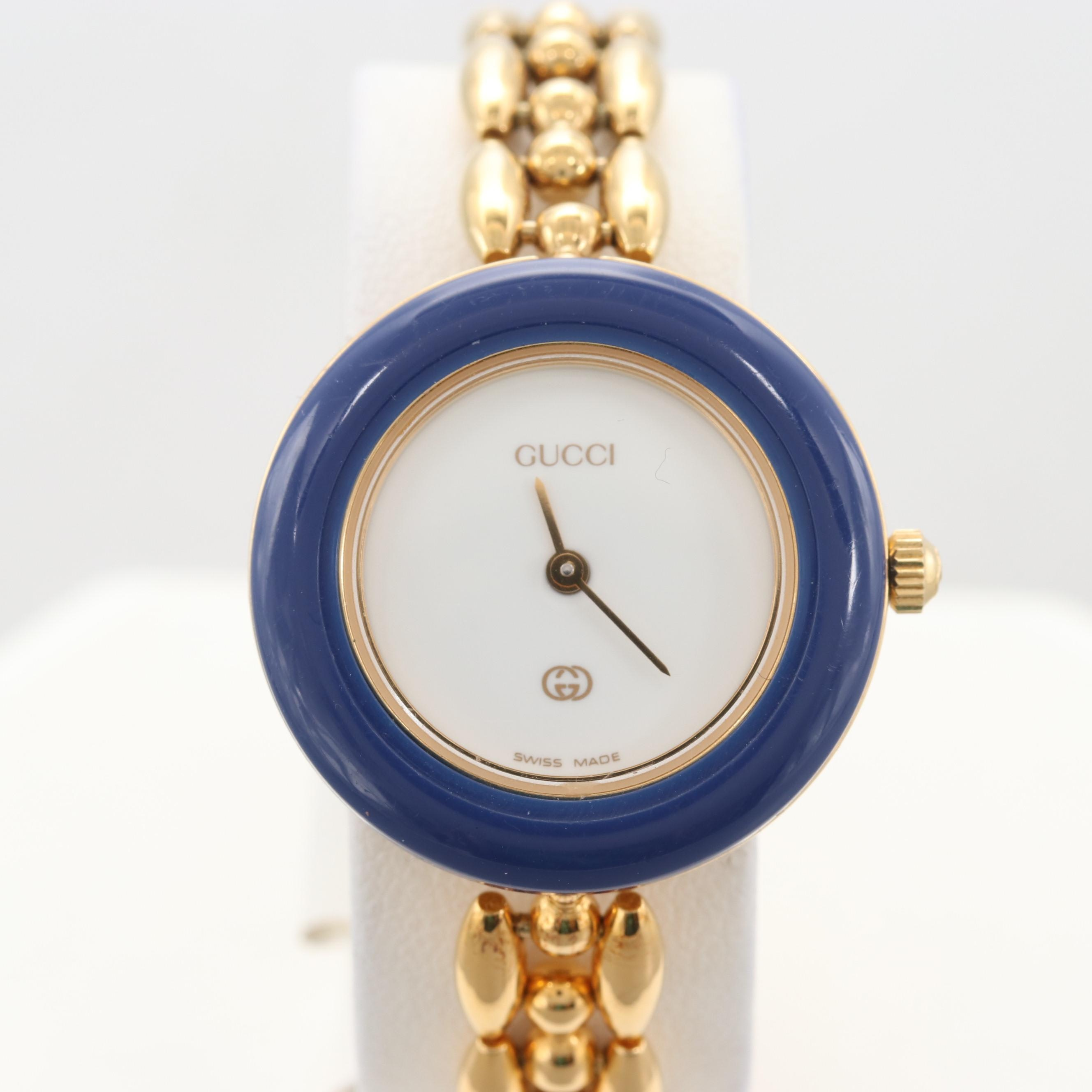Gucci Gold Tone Wristwatch With Interchangeable Bezels