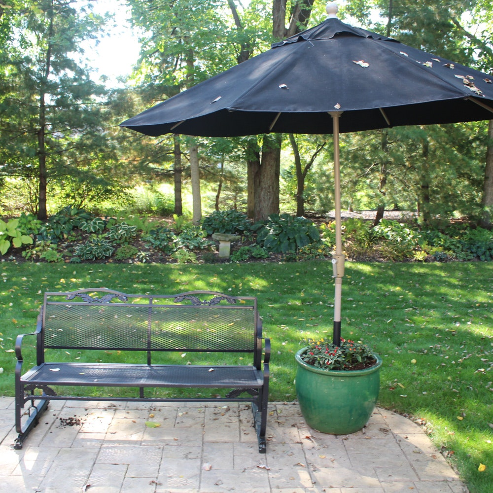 Black Metal Patio Glider Bench with Treasure Garden Umbrella and Planter
