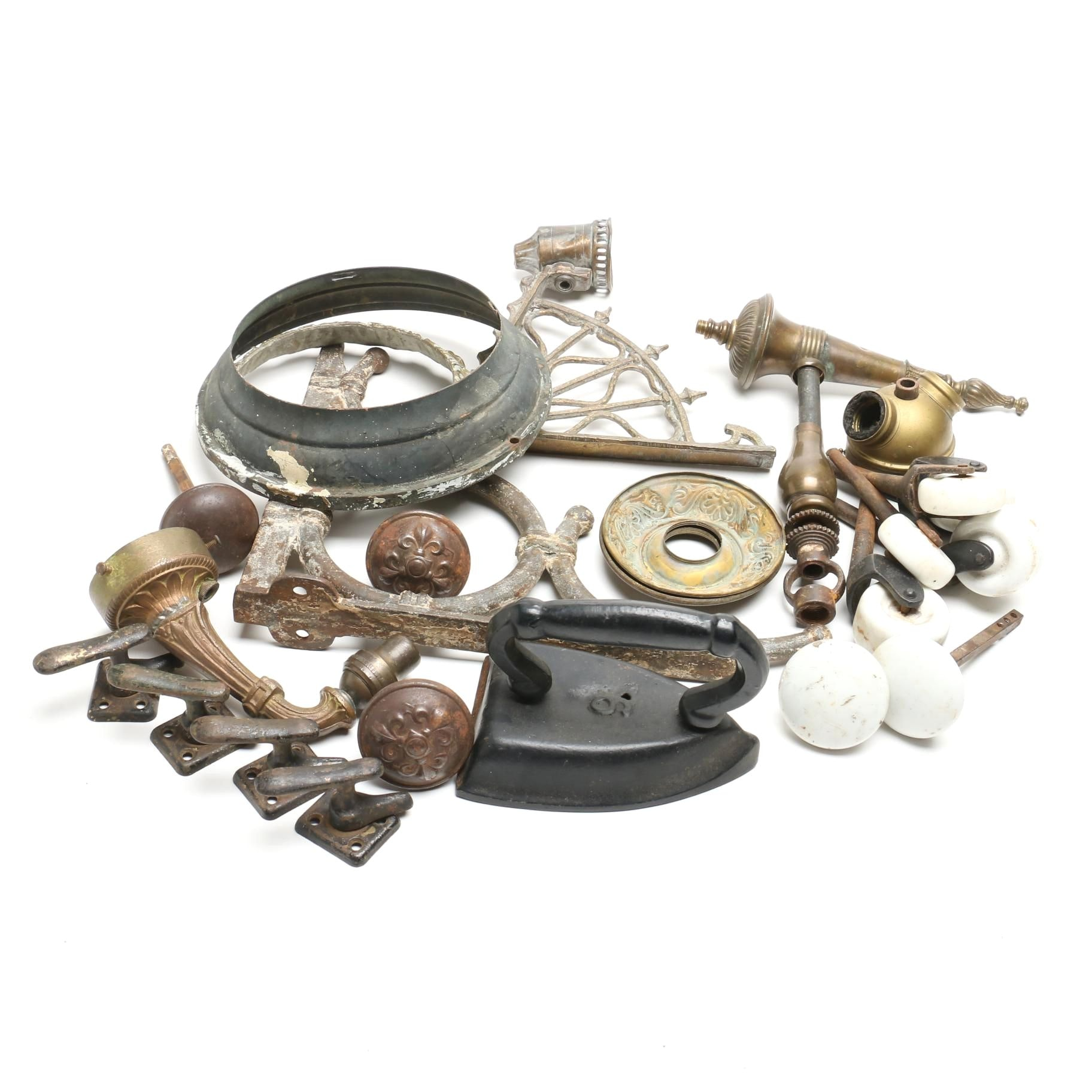 A Collection of Iron and Brass Wall Sconces, Door Knobs, Wheels and More