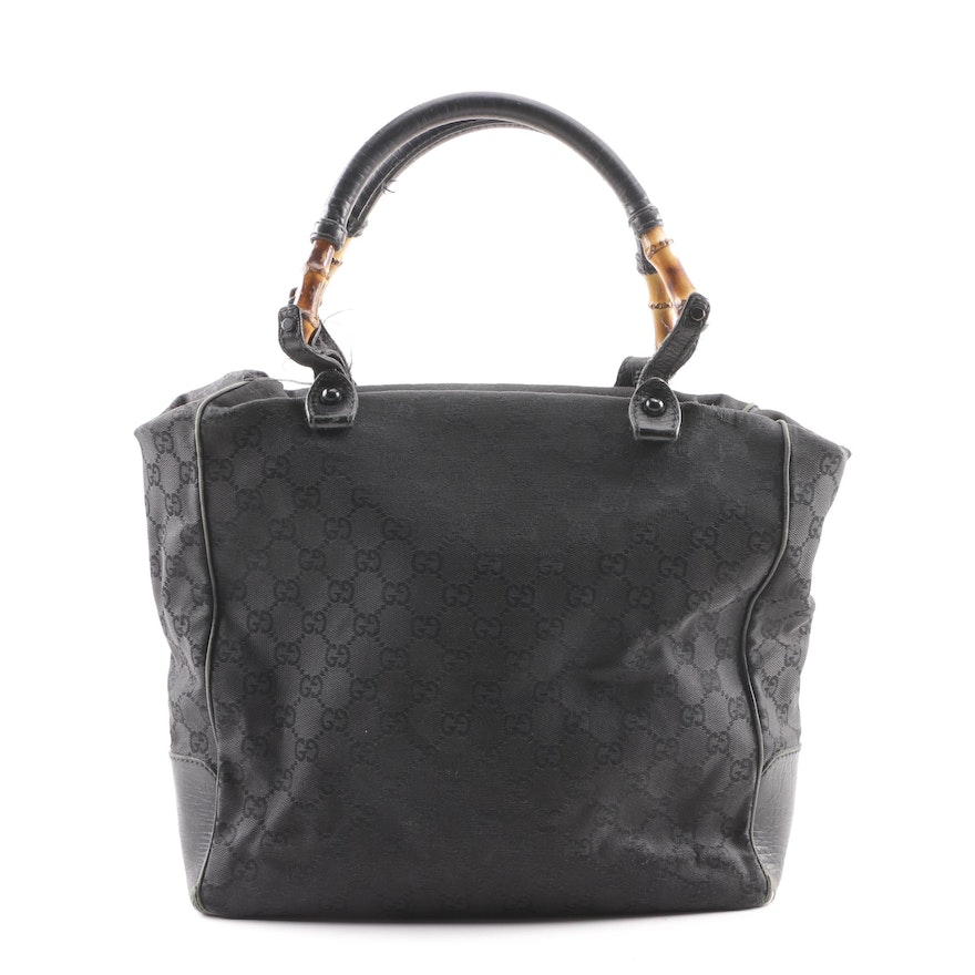 5d9d7f035c12 Gucci Black GG Canvas Tote with Bamboo Accented Handles