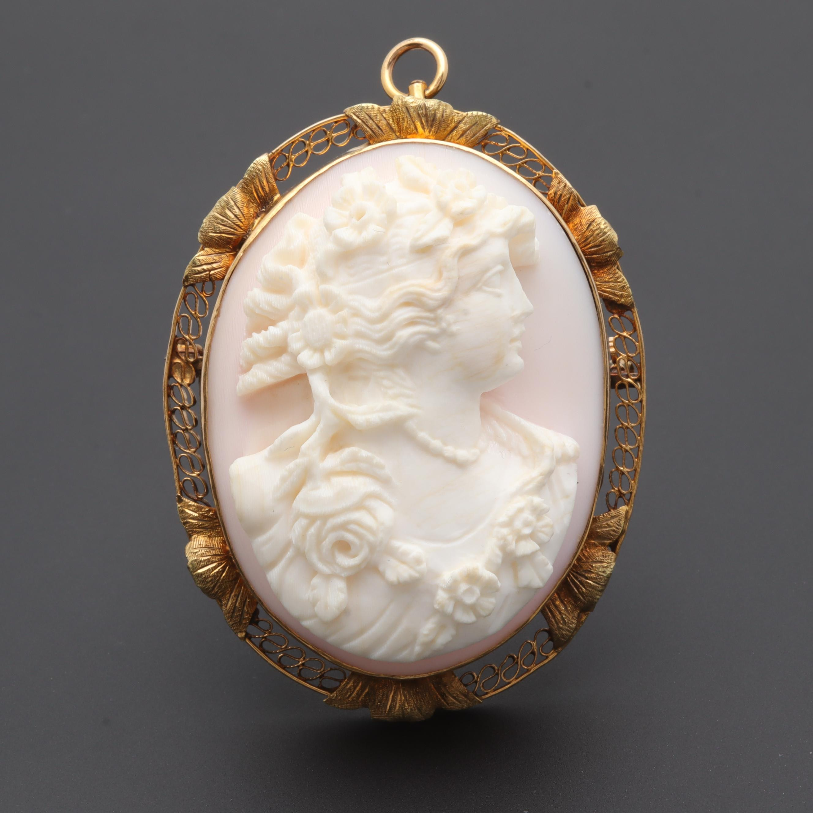 Circa Early 1900's 10K Yellow Gold Conch Shell Cameo Converter Brooch of Flora