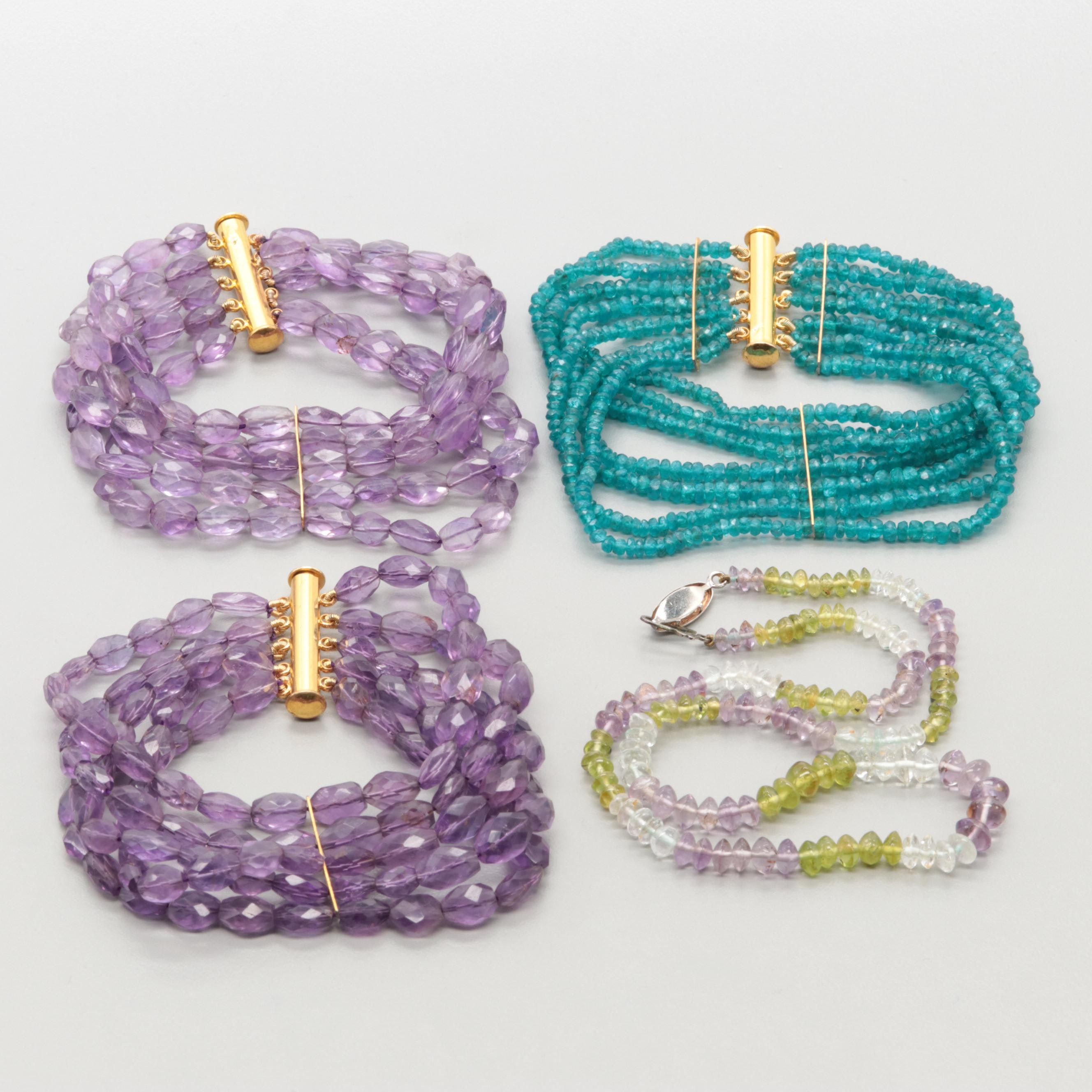 Gold Tone Beaded Necklace and Bracelets with Amethyst and Peridot