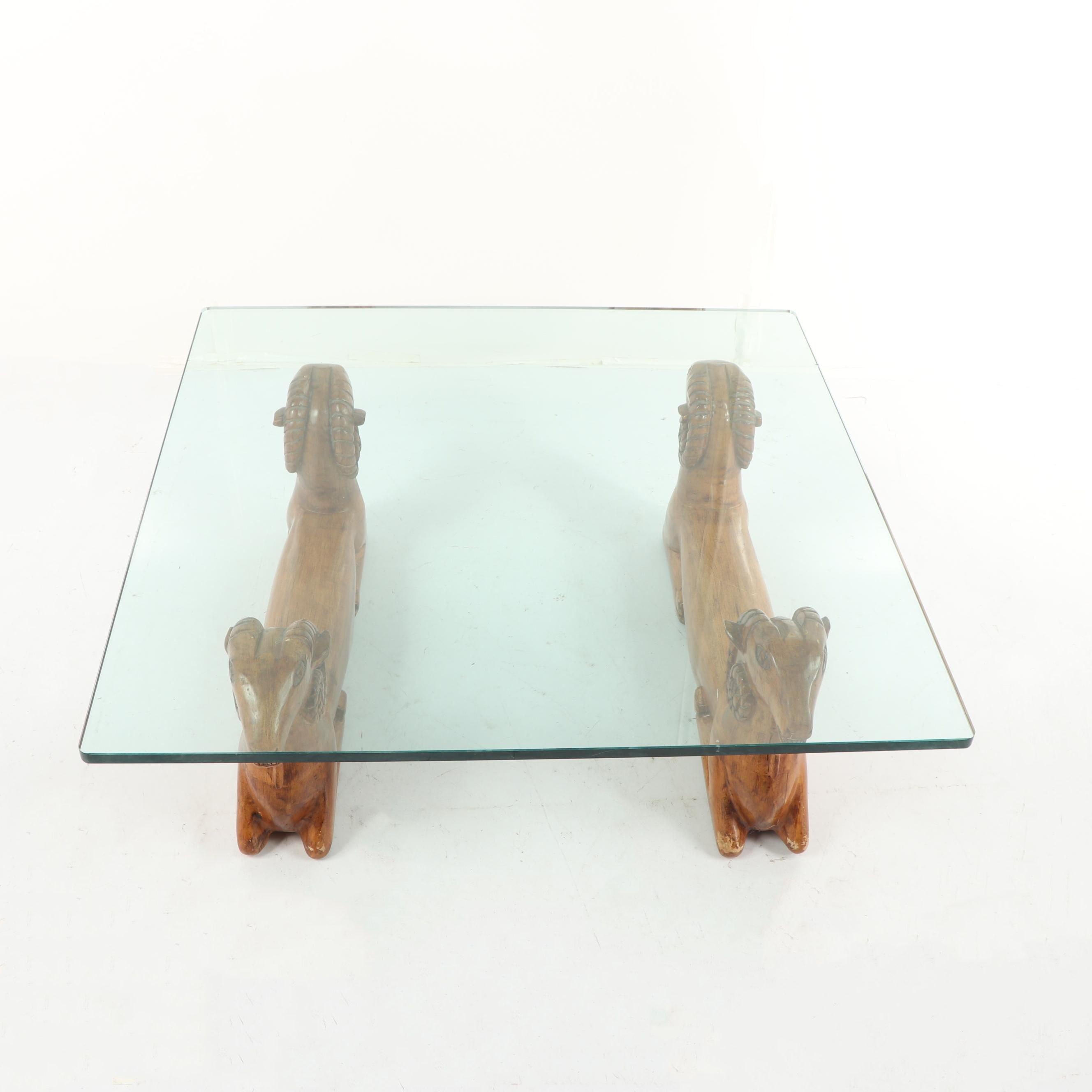 Contemporary Glass Top Coffee Table with Wooden Double Headed Ram Base