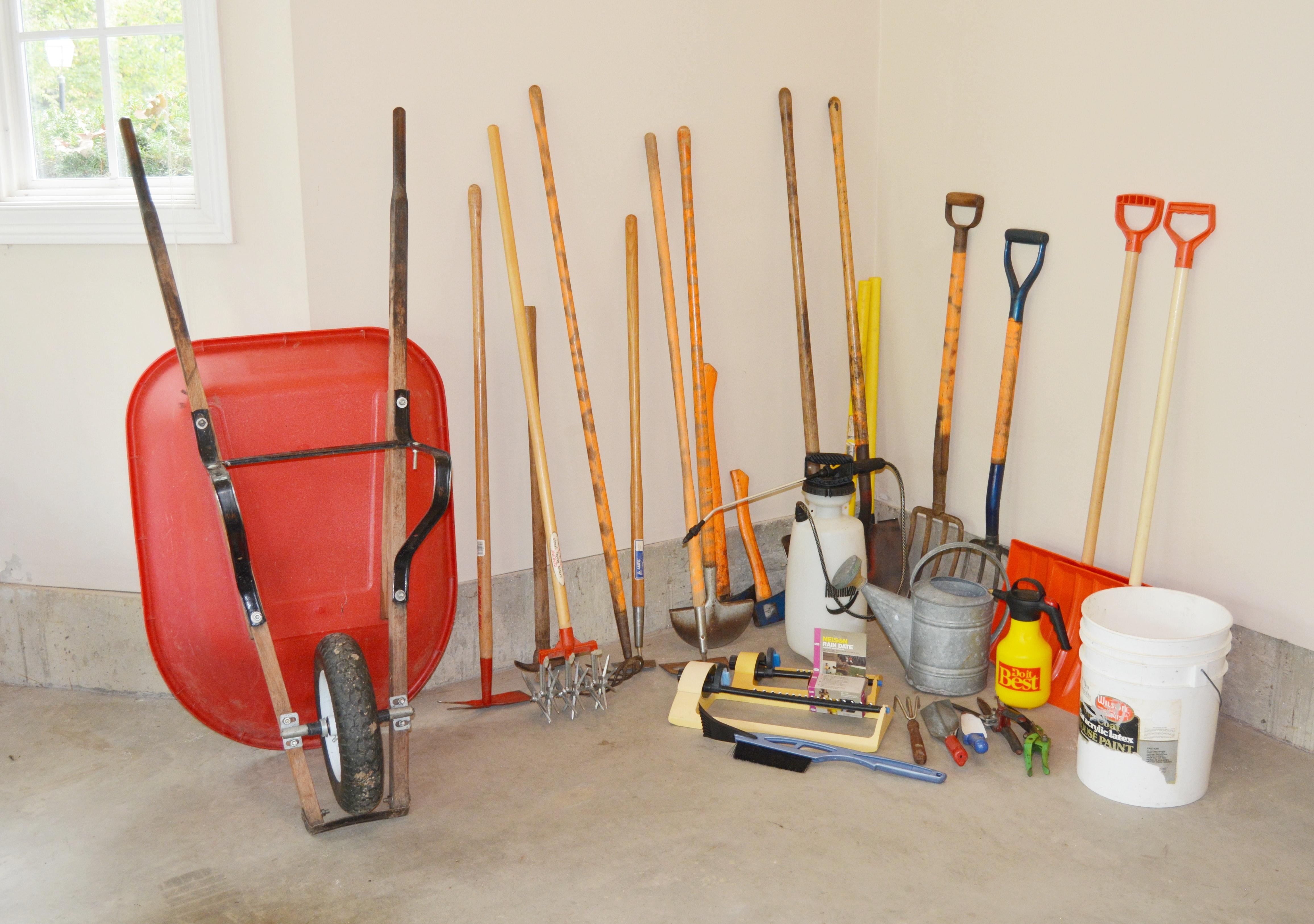 Collection of Garden Tools and Wheelbarrow