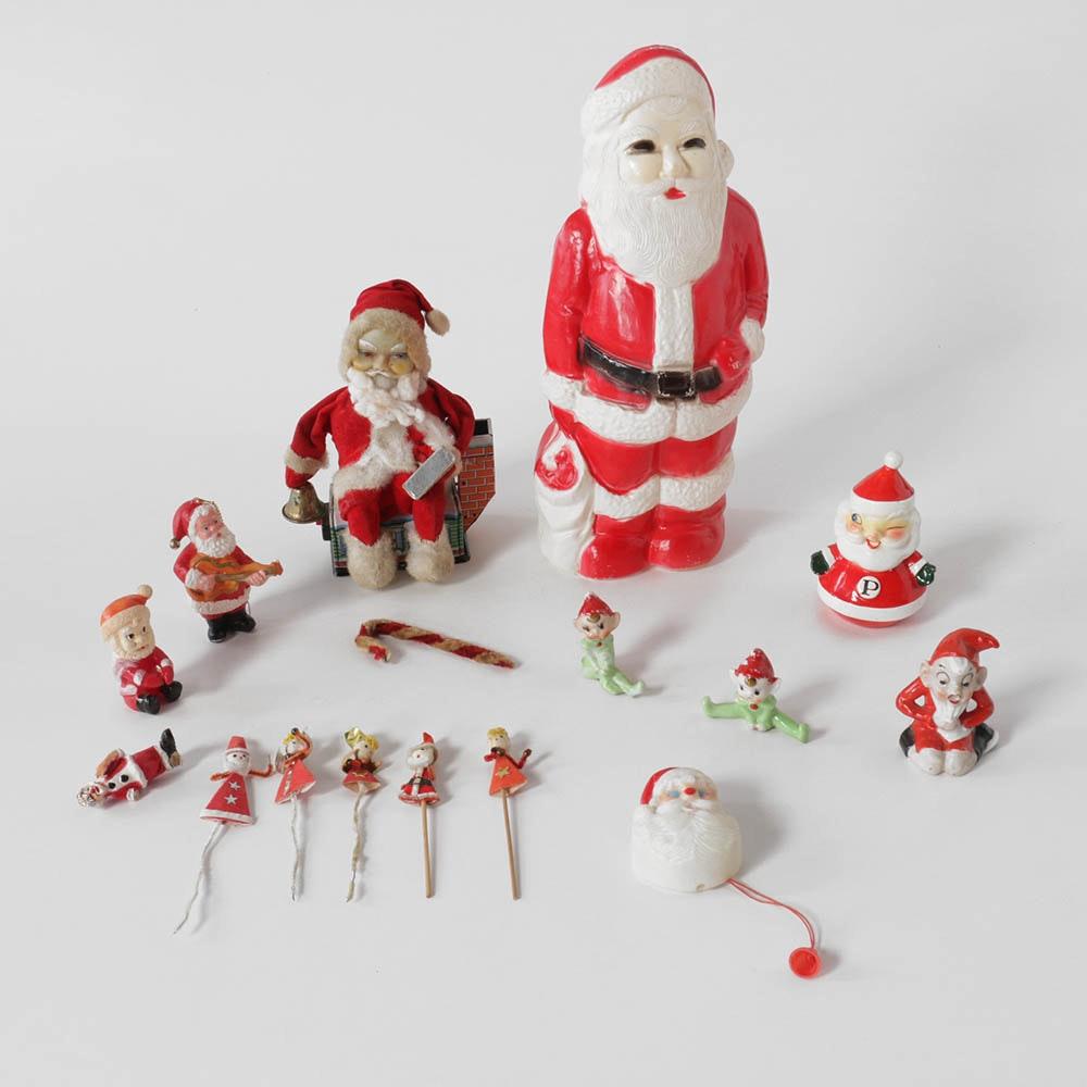 Vintage Santa and Elf Figurines with Animated Santa Figurine on Tin House