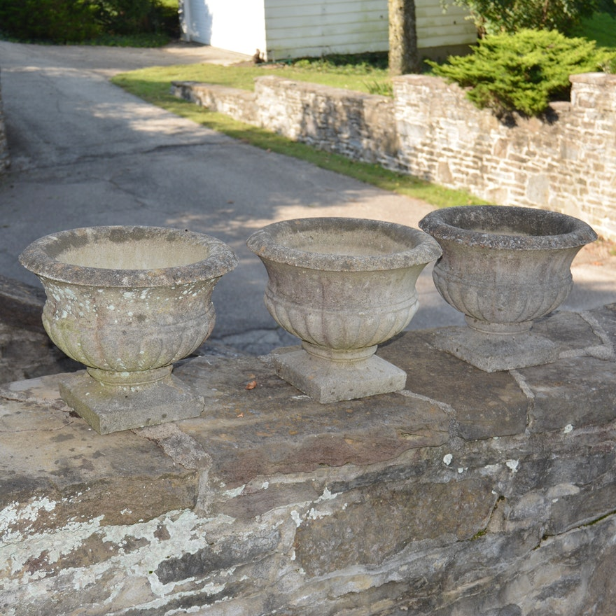 Three Low Urn Shaped Concrete Garden Planters Ebth