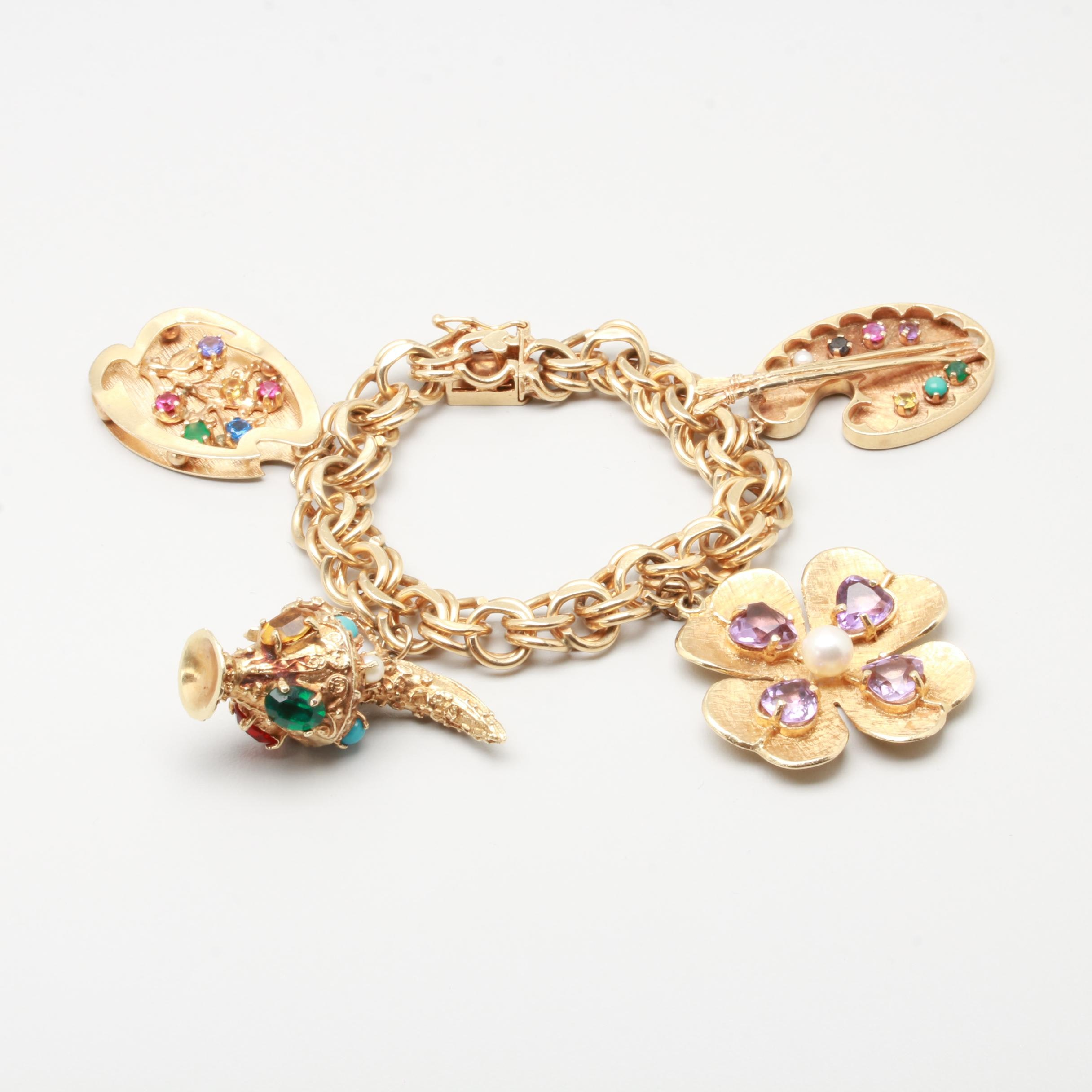 14K Yellow Gold Charm Bracelet Including Synthetic Ruby and Synthetic Sapphire