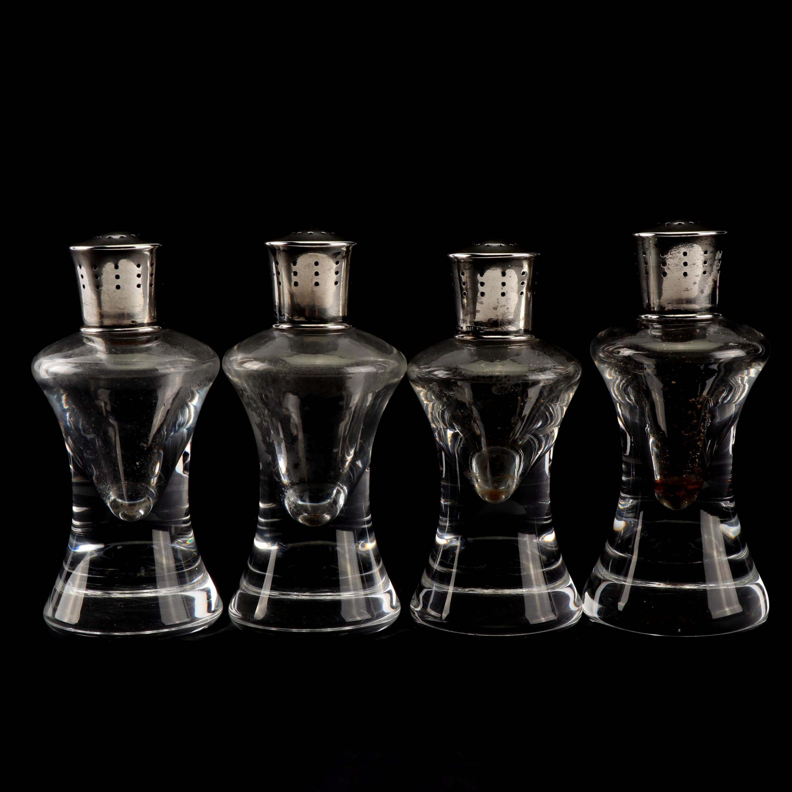Four Steuben Glass and Silver Salt and Pepper Casters